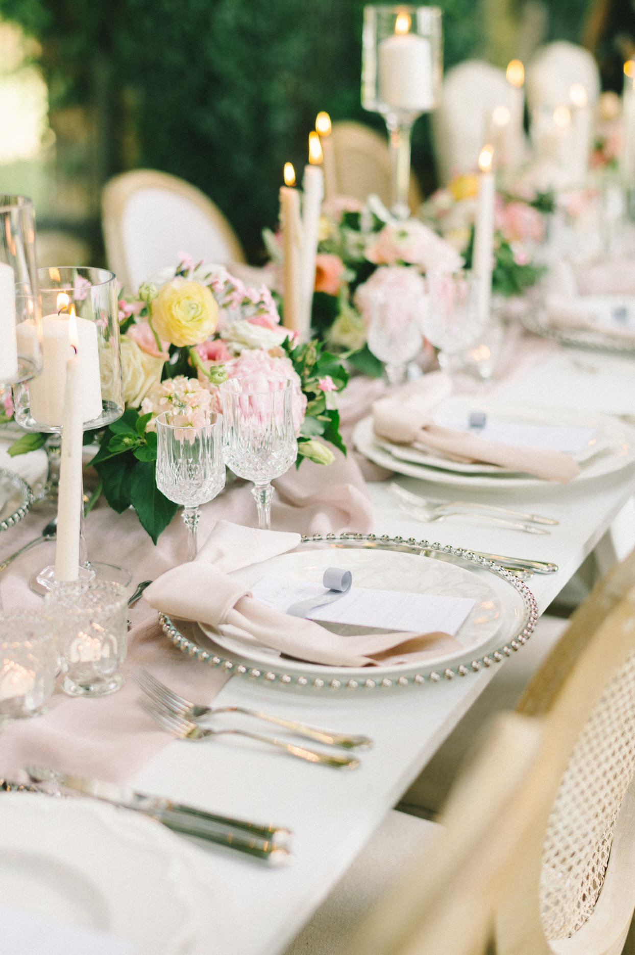 wedding place setting with cream and blush color scheme and florals
