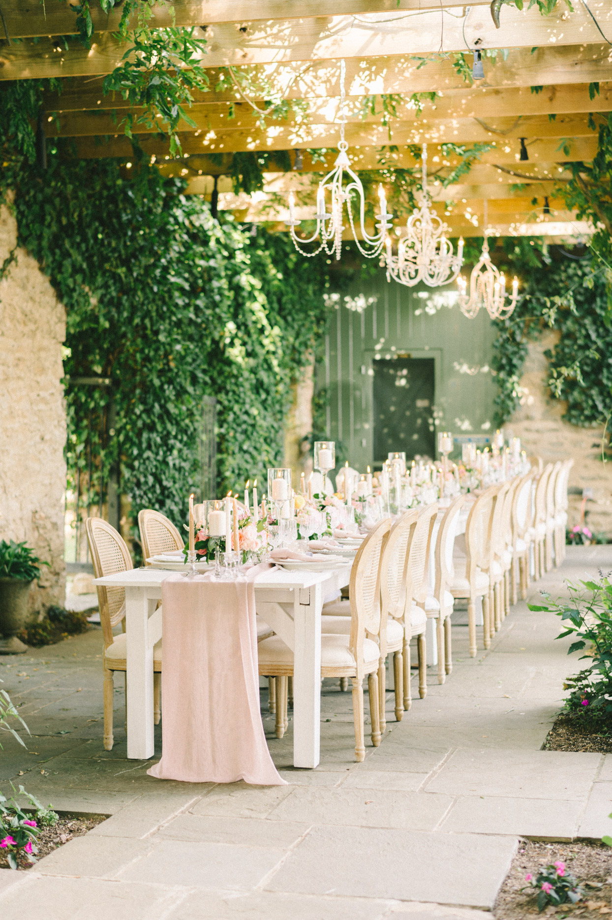 wedding reception white long table with blush runner