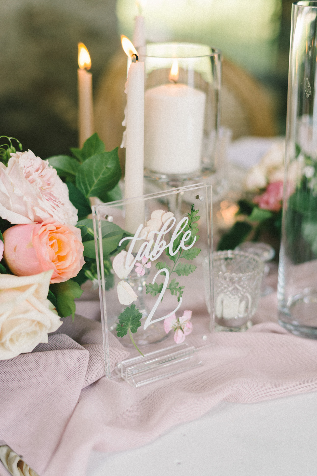 clear table numbers on blush table runner