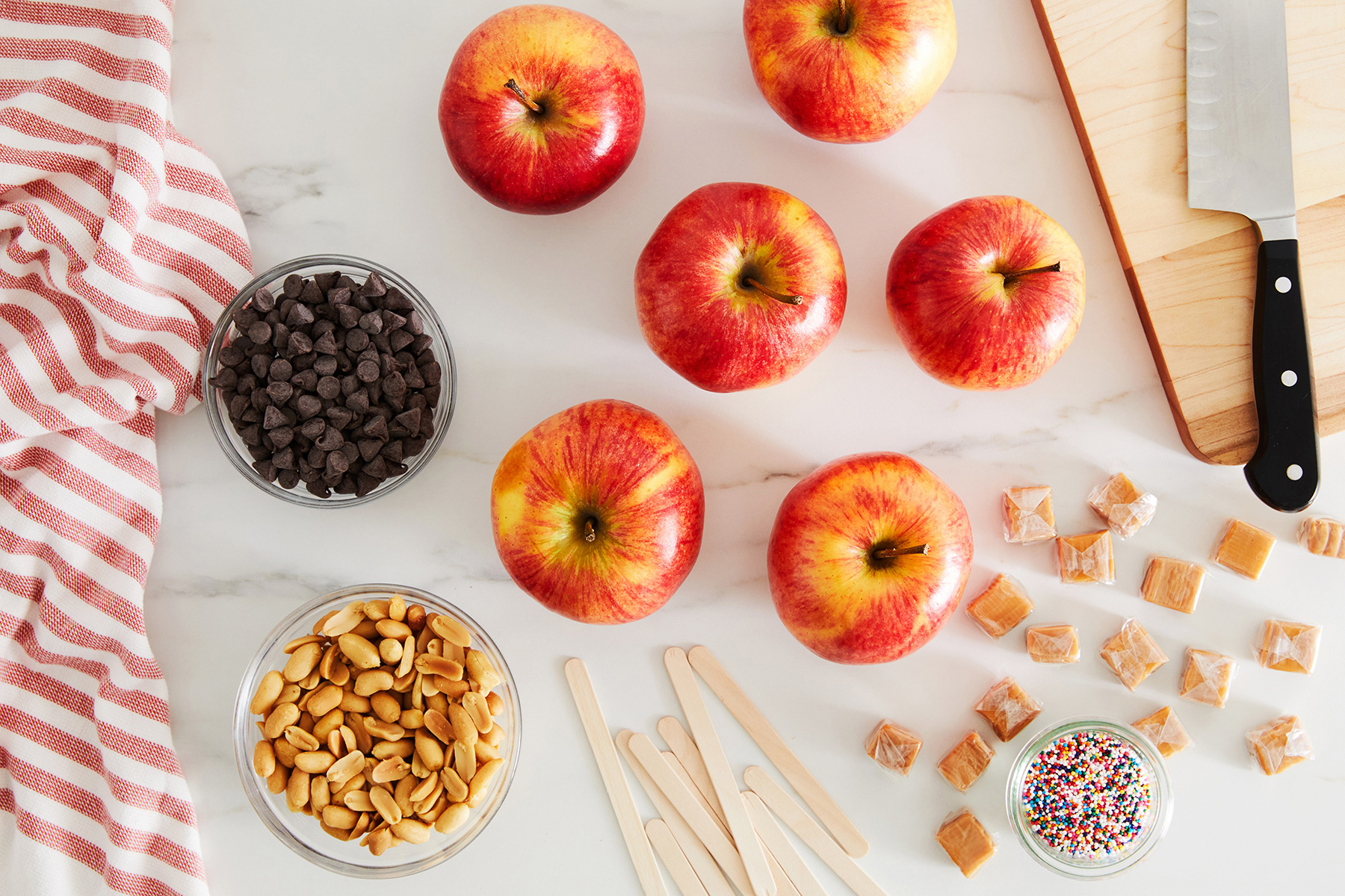 ingredients atop countertop for candy apples
