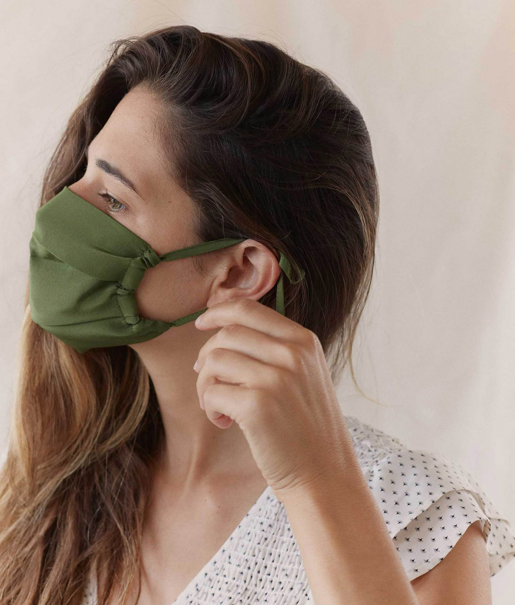 side view of woman wearing Olive Sustainable Mask in Adult Silk