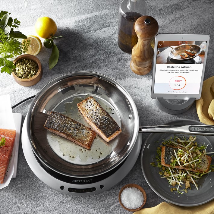 single induction burner being used to prepare salmon filets