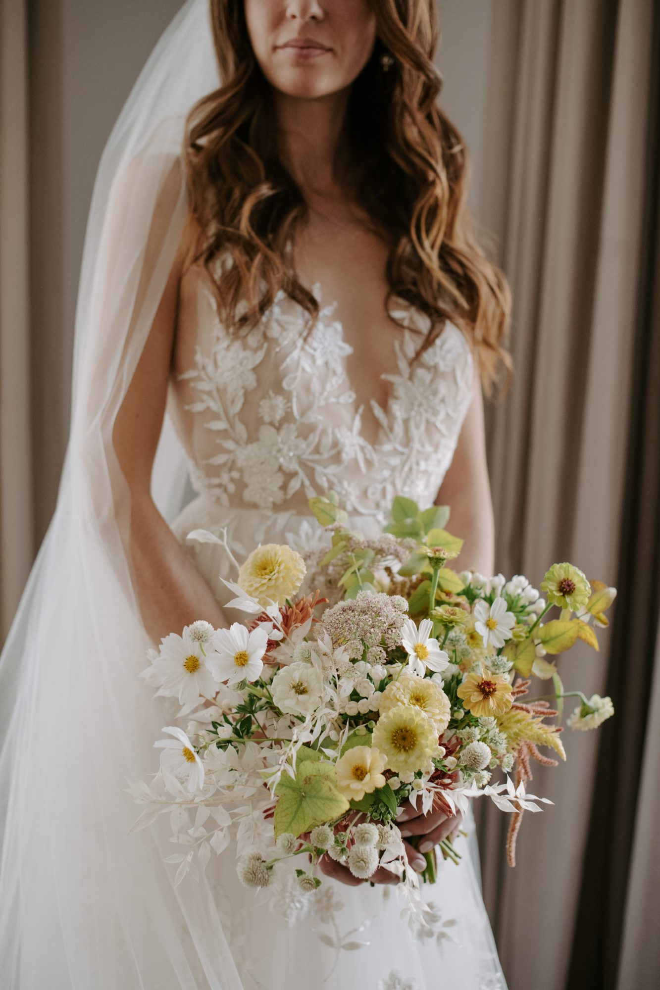 jenny and paul wedding bride wearing dress and holding floral bouquet