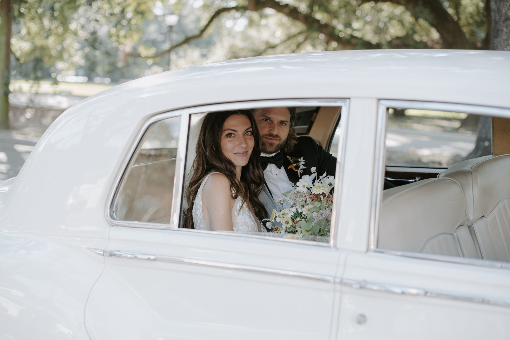 jenny and paul wedding couple riding in a vintage rolls royce