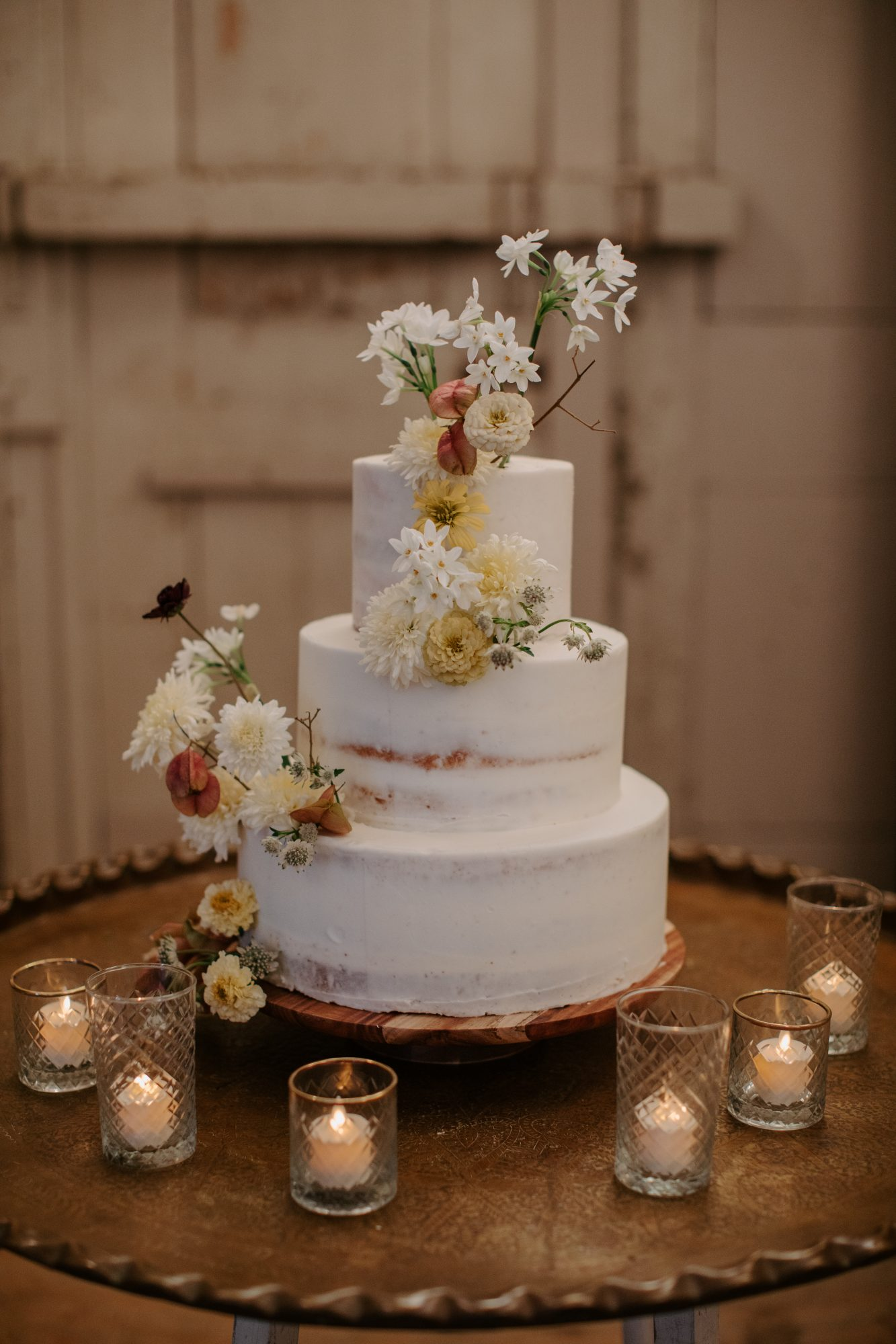jenny and paul wedding white cake with floral accents