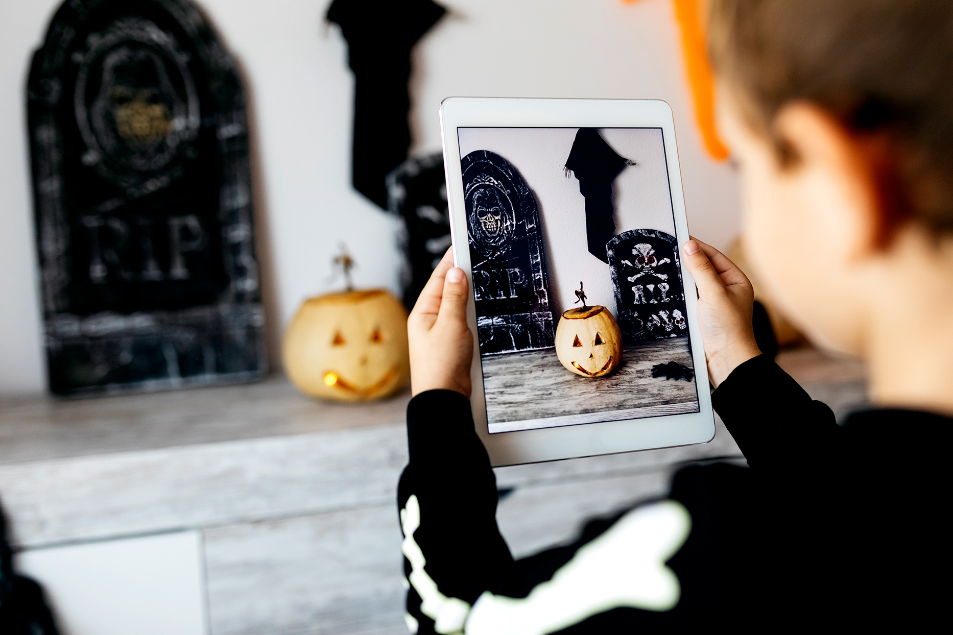child watching Halloween content on tablet