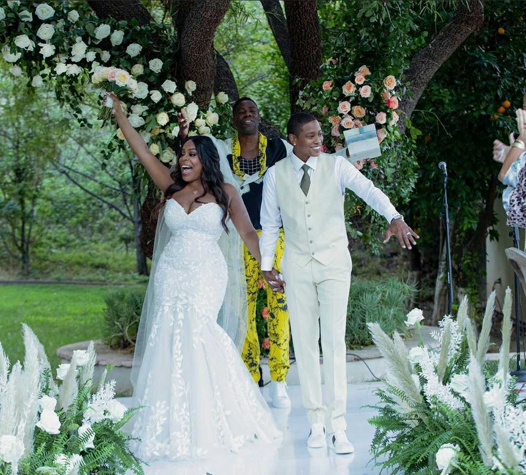 niecy nash and jessica betts walking down aisle after wedding ceremony