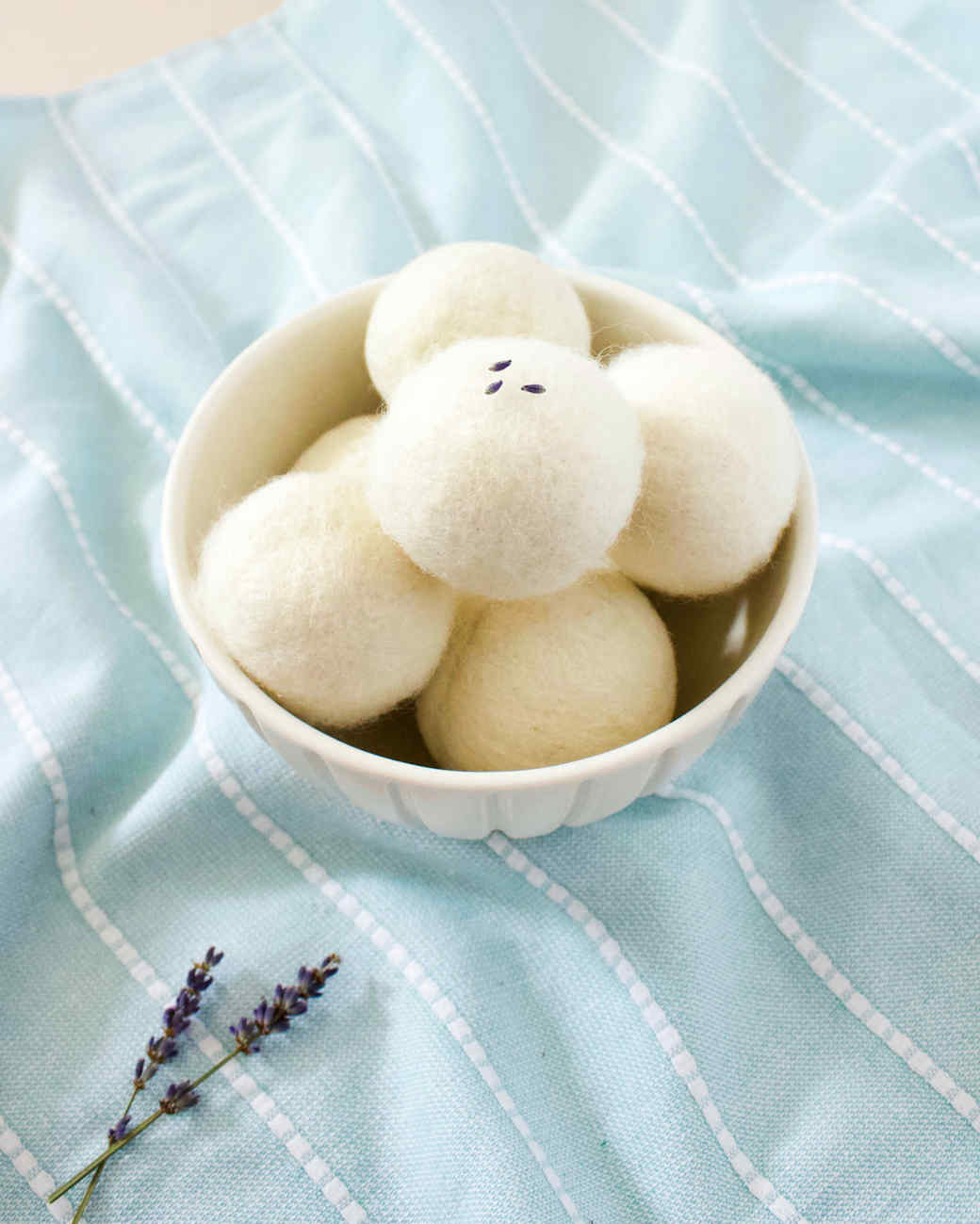 bowl of wool dryer balls and lavender sprigs