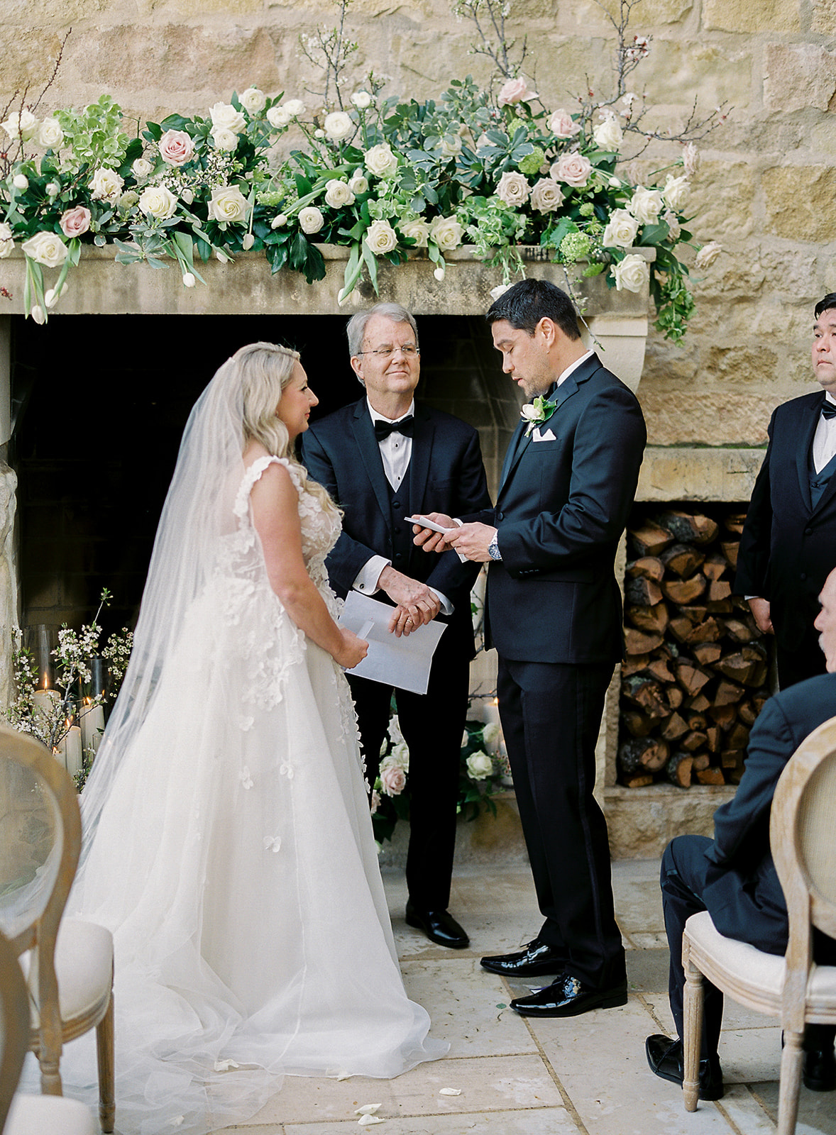 groom saying his vows to bride during wedding ceremony