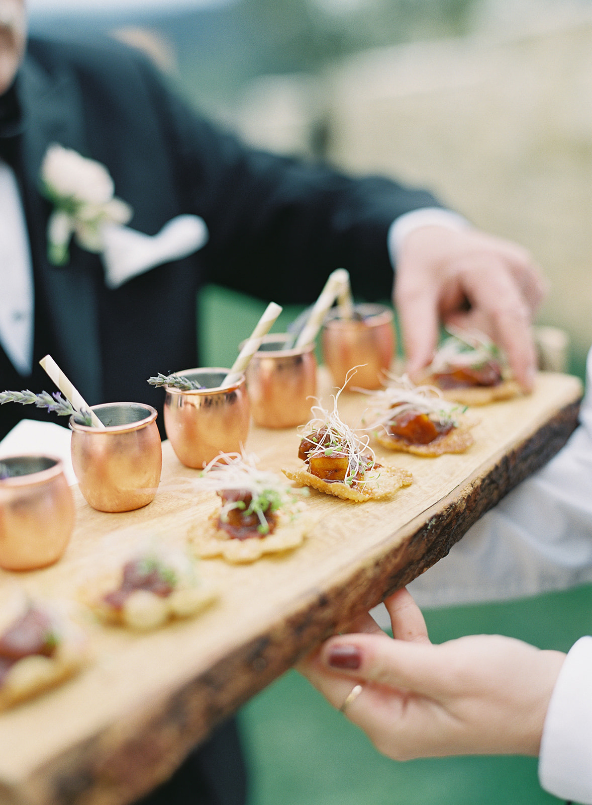 cocktail and appetizer pairing on wooden serving tray