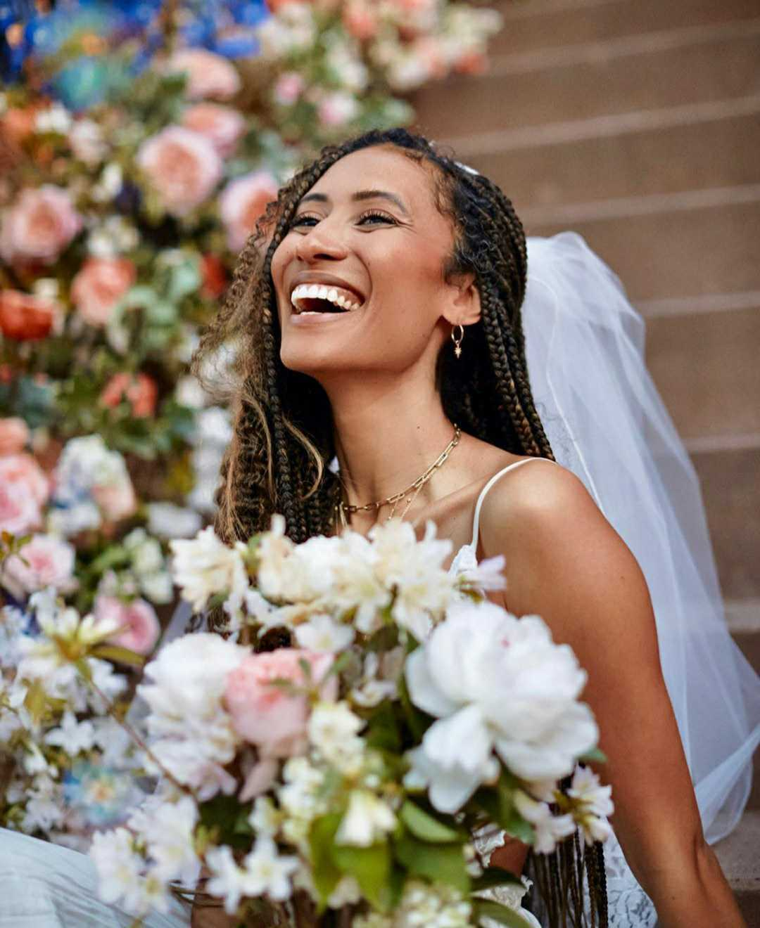 elaine welteroth wedding photo from her socially distanced event on her floral Brooklyn stoop