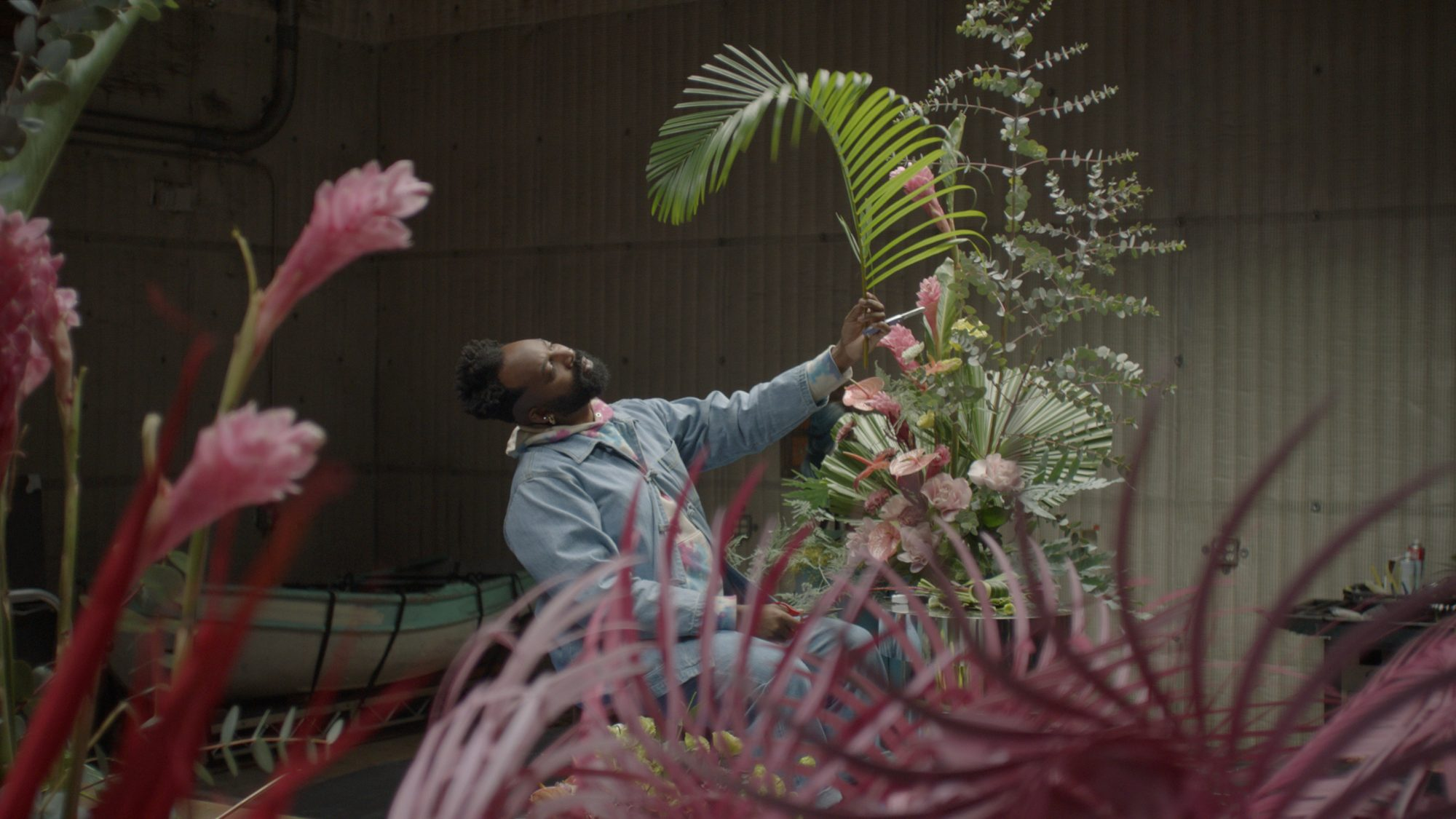 Maurice Harris designing a floral installation