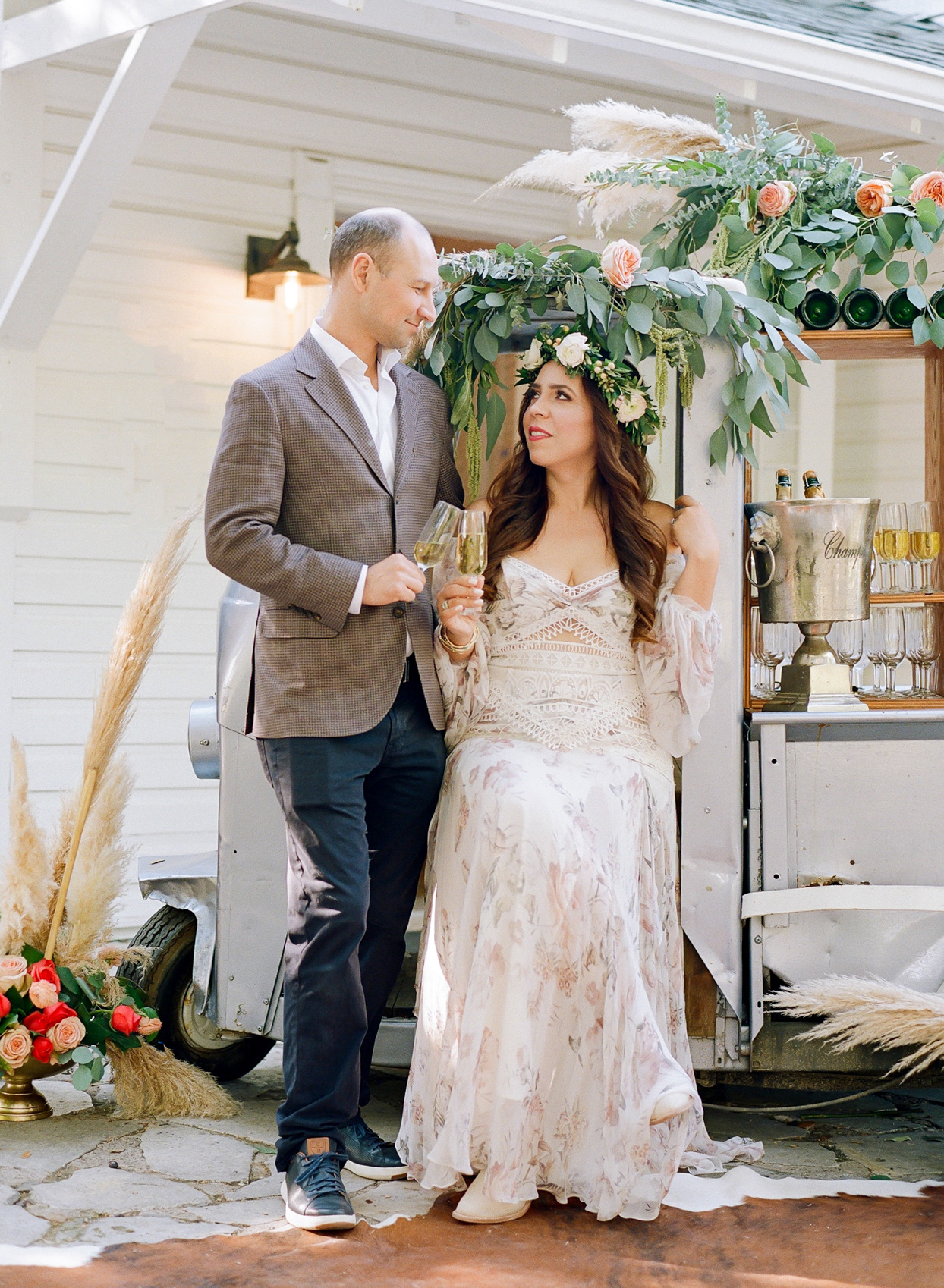 couple sitting on champagne cart at wedding brunch