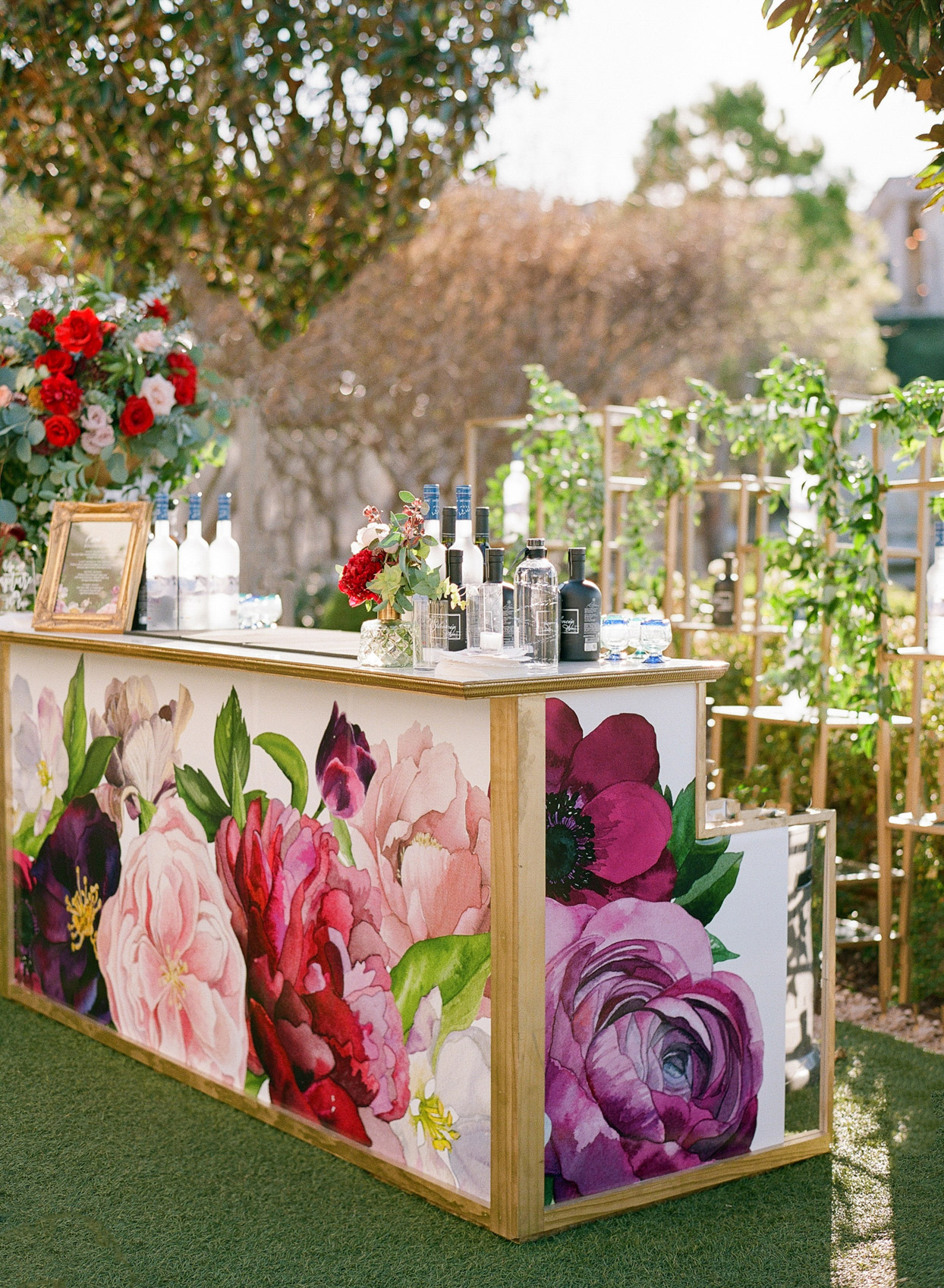 outdoor wedding car decorated in large floral design
