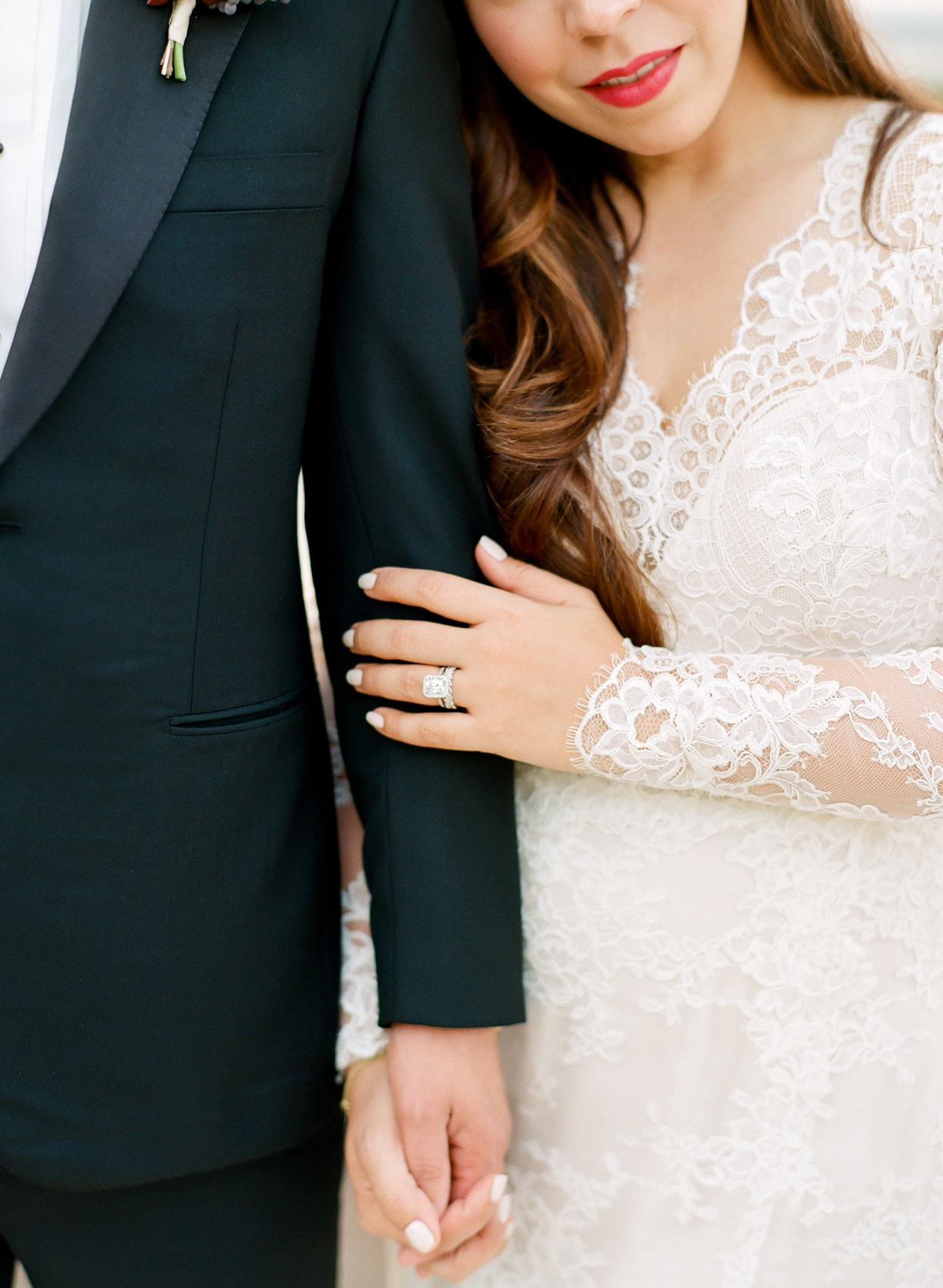 couple posing for close up portrait of bride's wedding ring