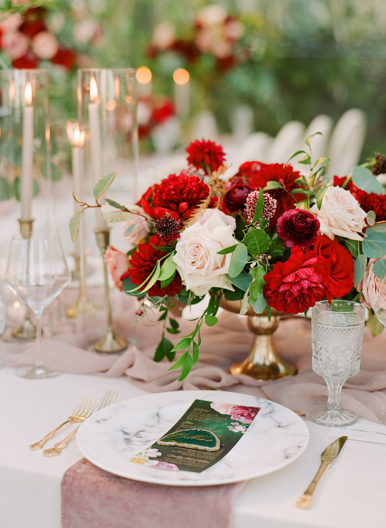 gold and red centerpiece at fall wedding