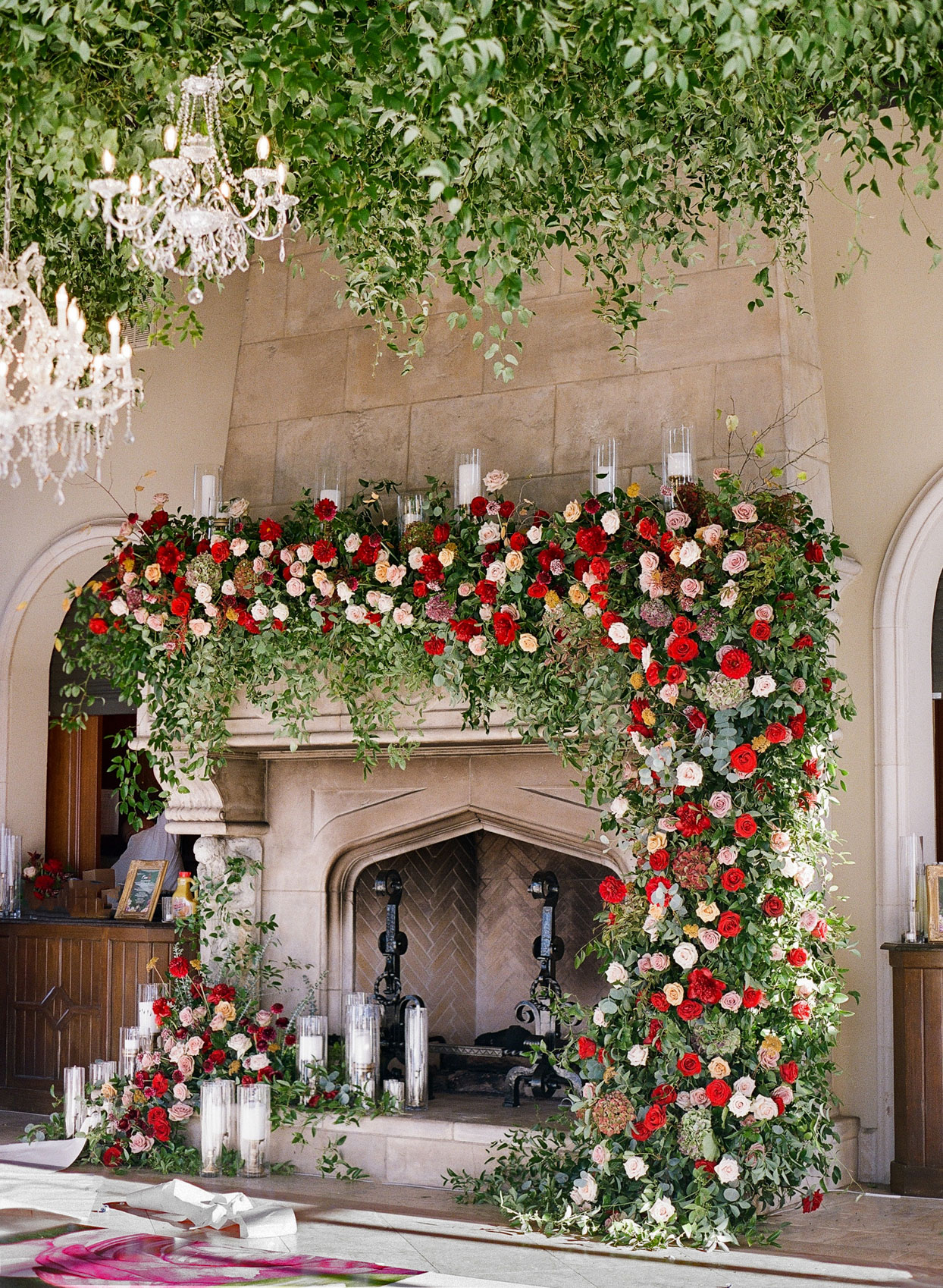 wedding reception fireplace with floral garland