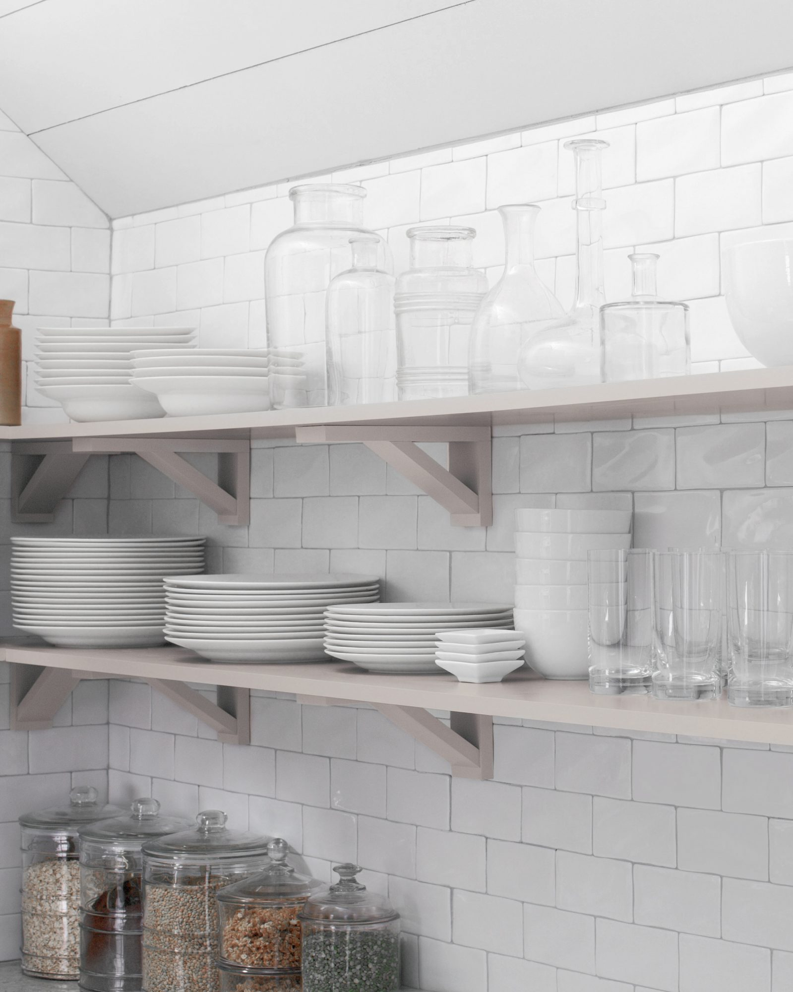 open shelving with white and glass dishes