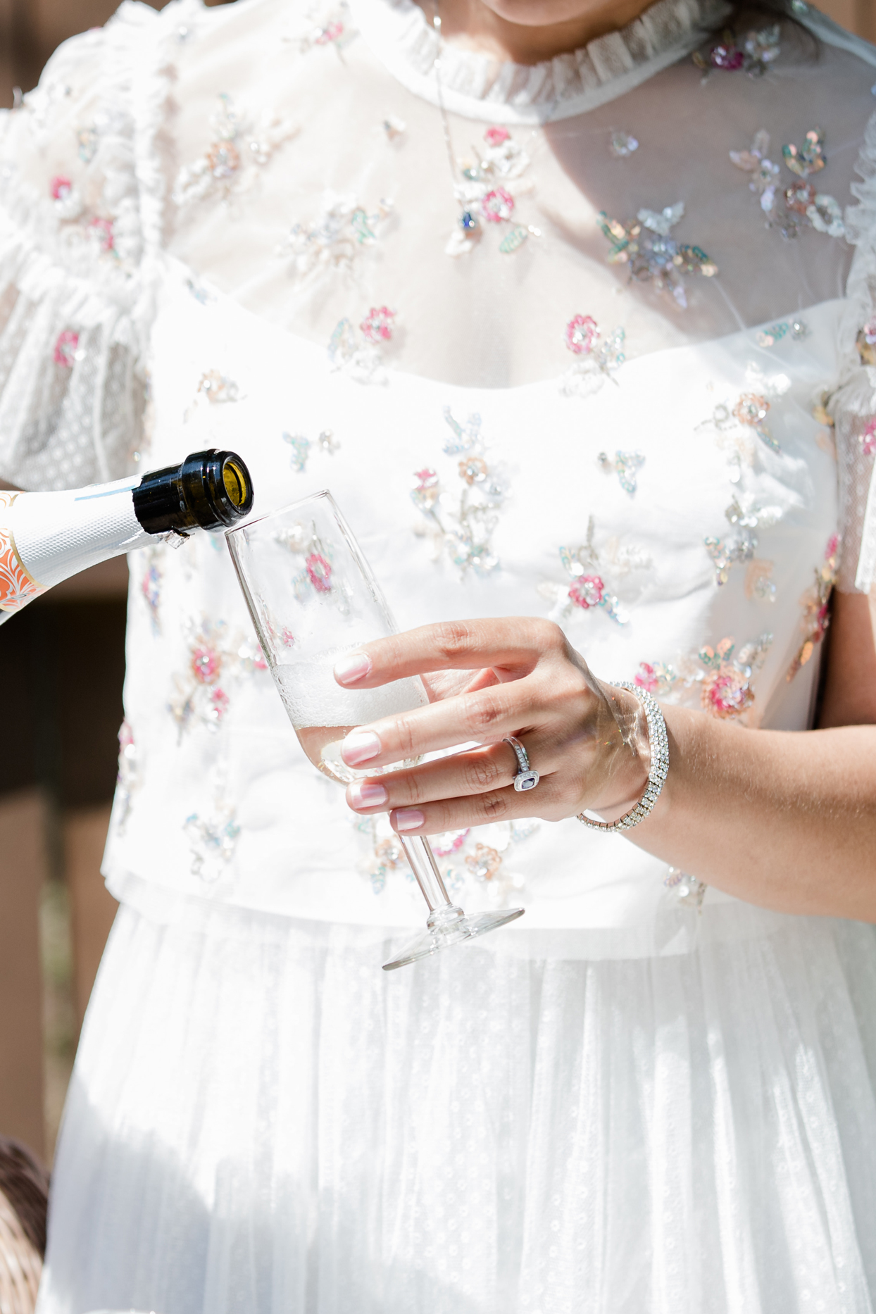 bride pouring glass of champagne