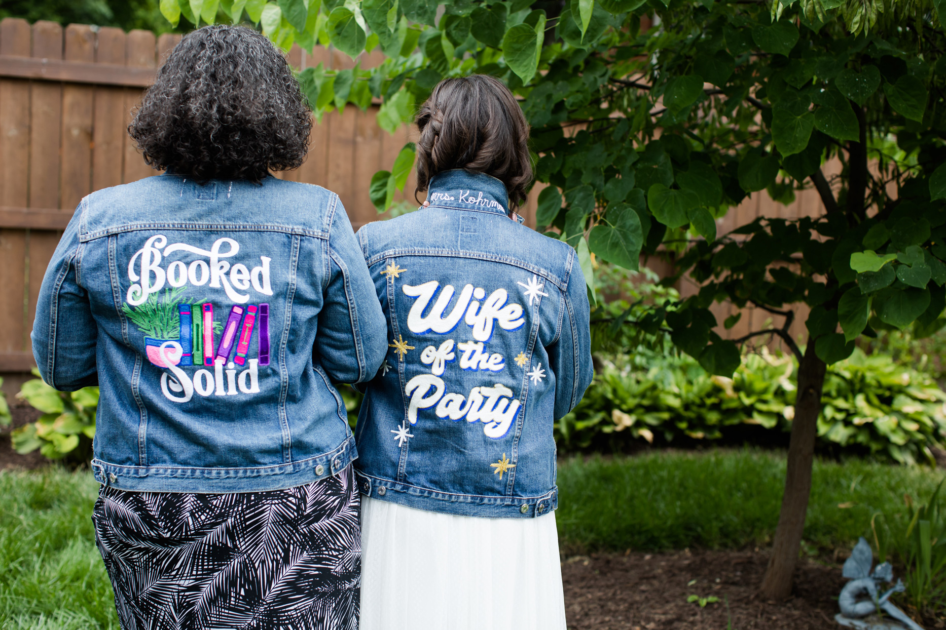 bride and sister wearing customized jean jackets