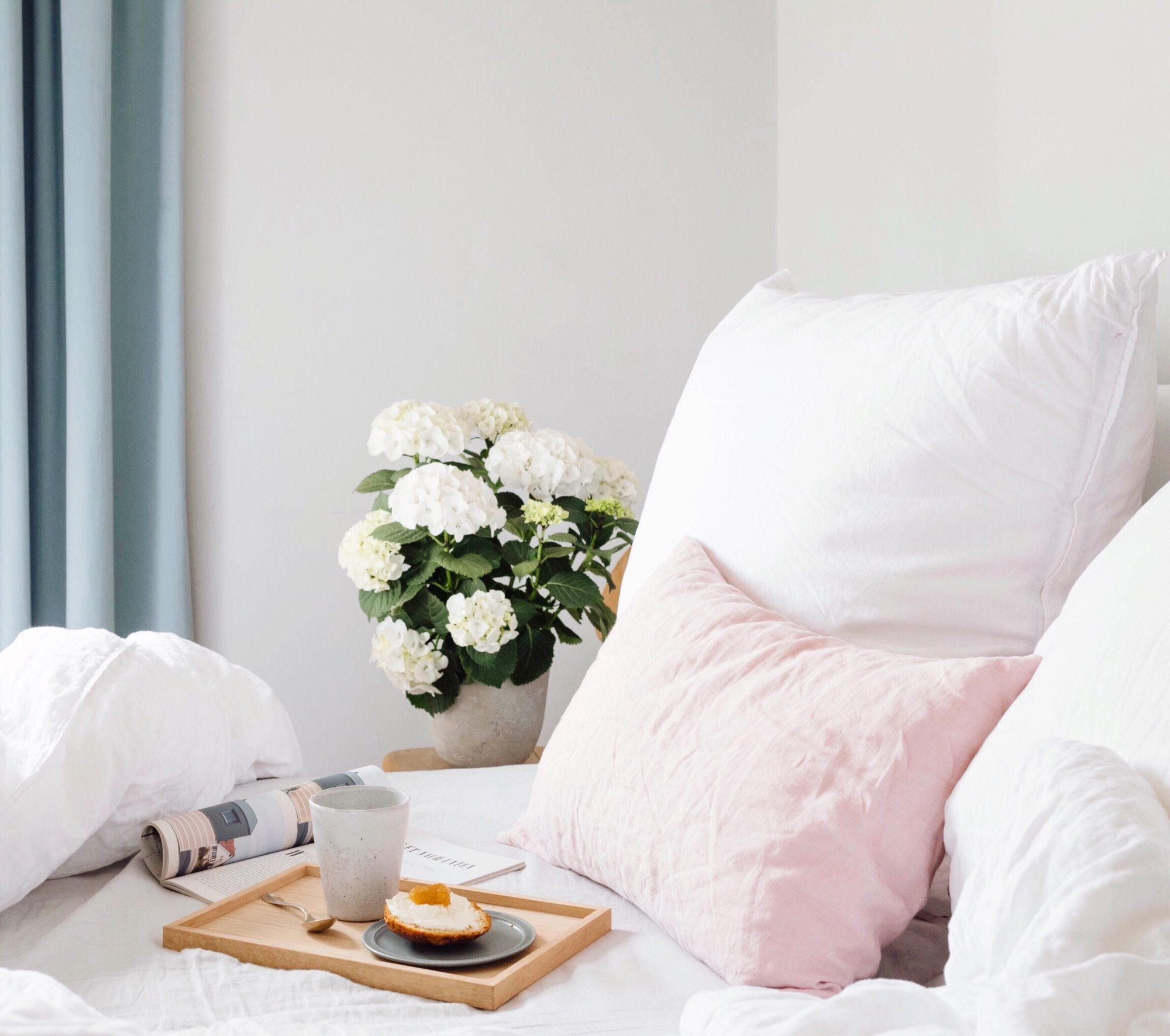 Pretty Bed with Flowers and a Breakfast Tray