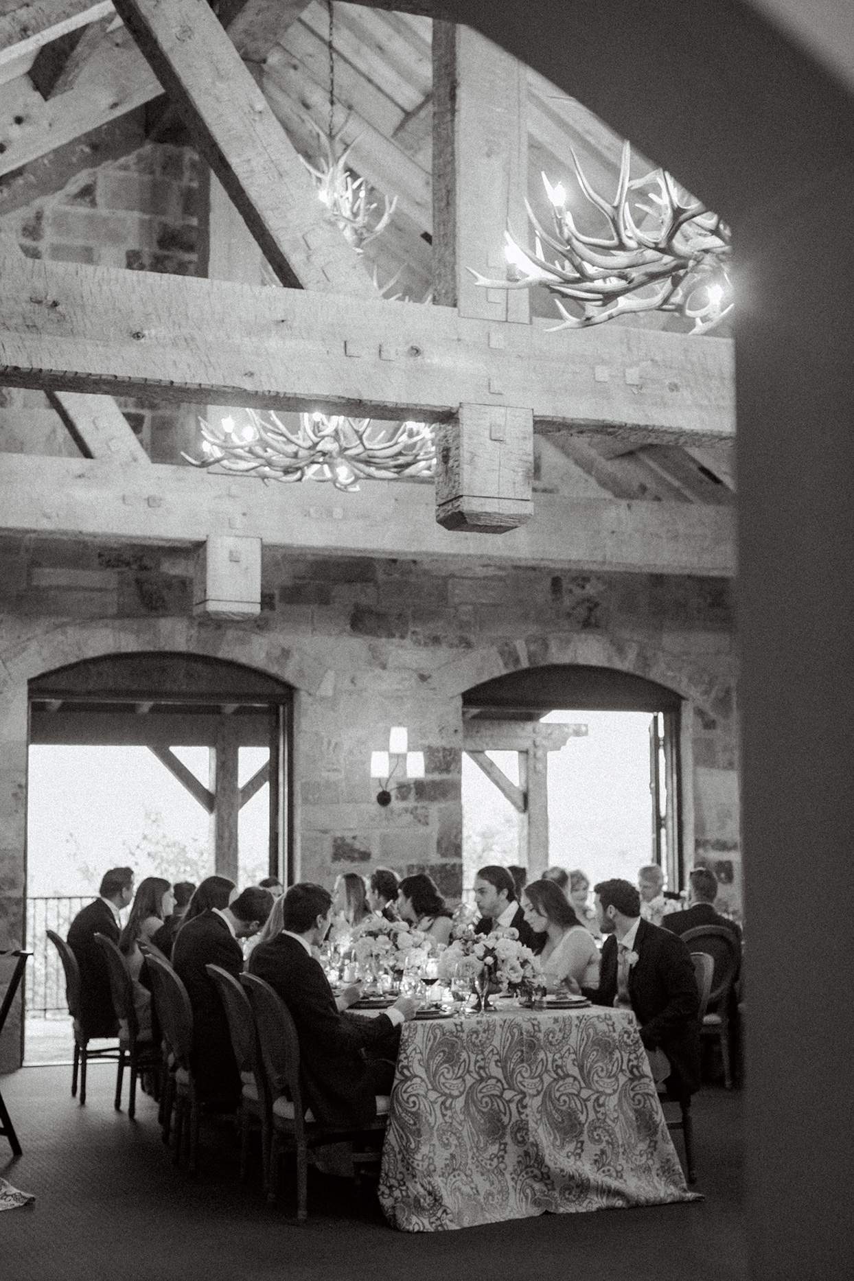 intimate wedding reception inside with long tables