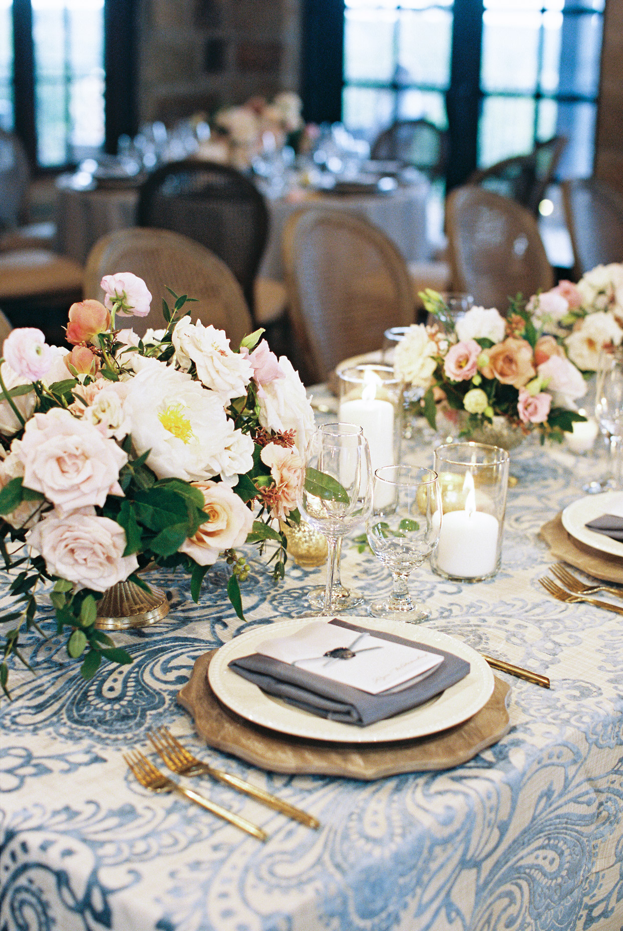 white and blue paisley print table cloth covered reception table