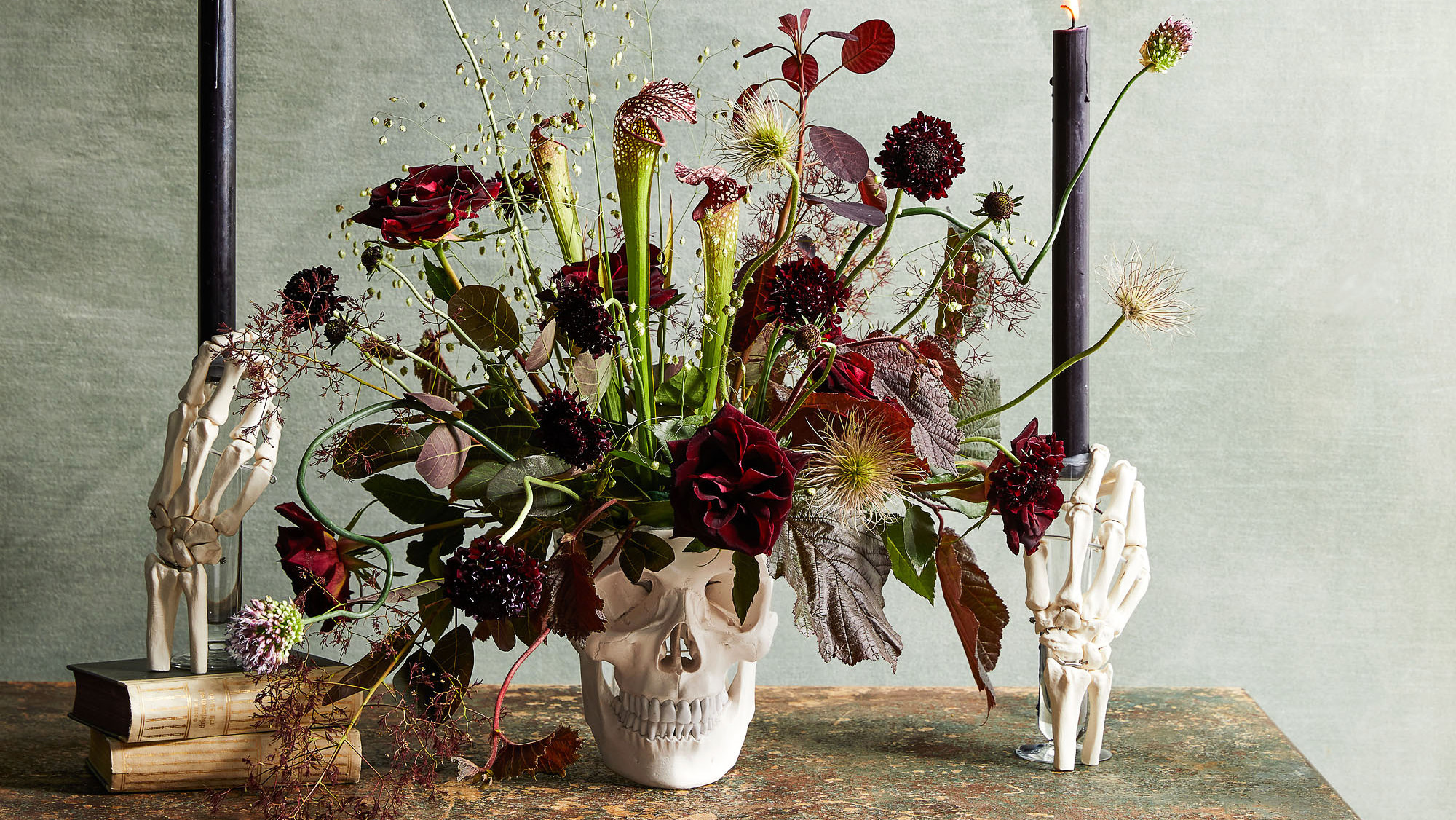 floral arrangement in a skull and anatomical hands