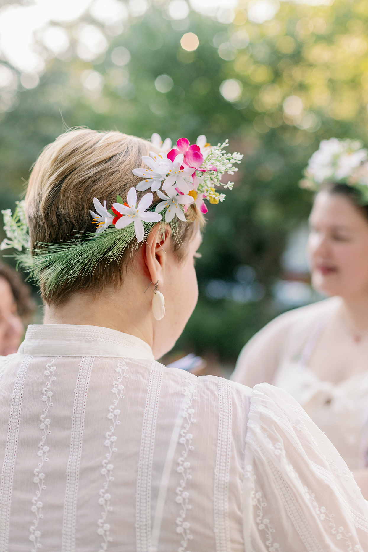 brides wearing flower crowns during ceremony