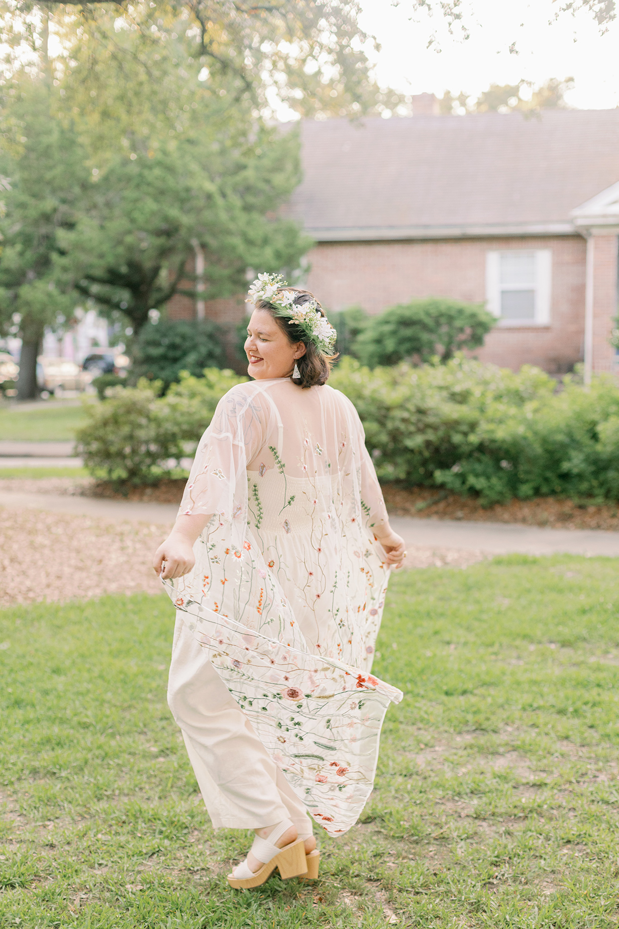 bride wearing cotton jumpsuit with embroidered duster