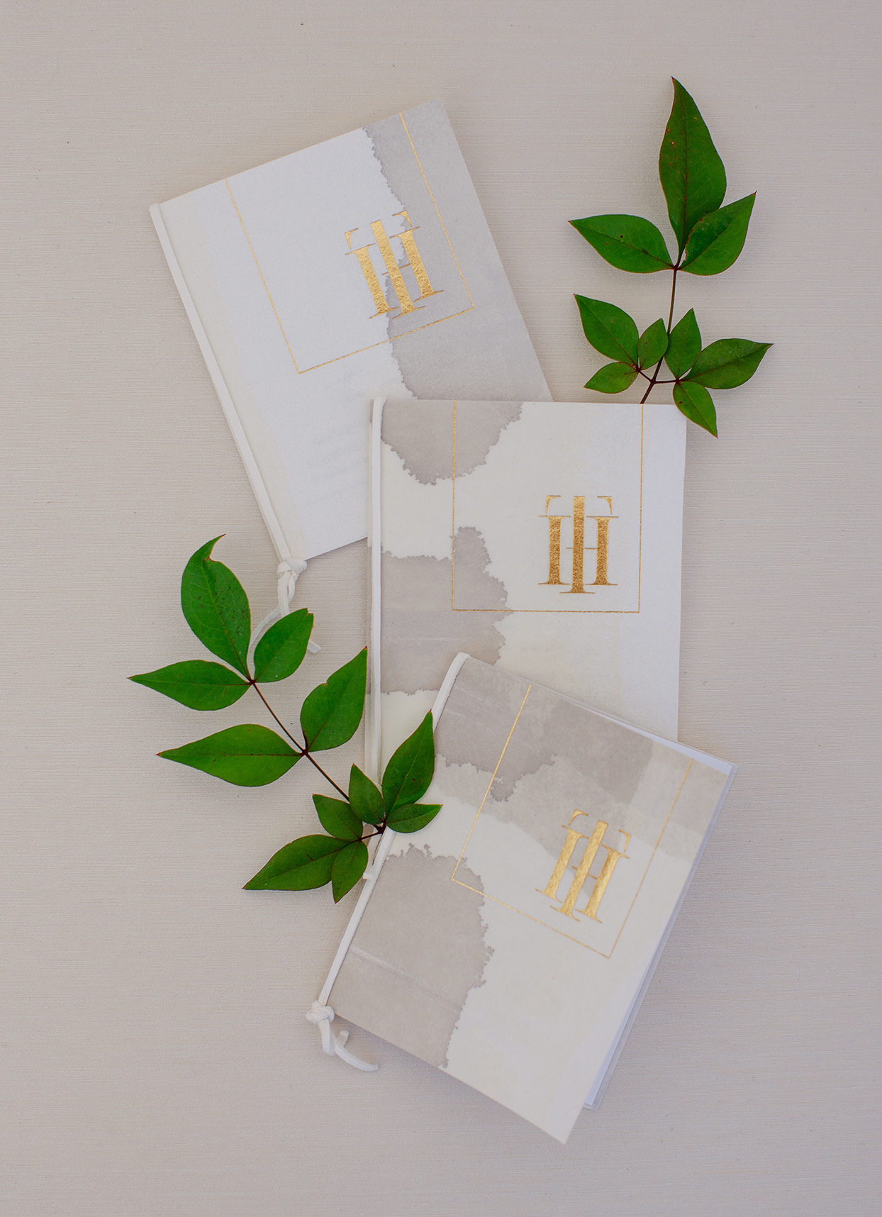 white and gray paper design with gold foil lettering ceremony programs