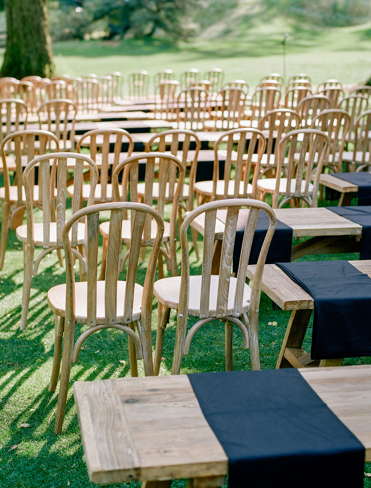 mixture of wooden chairs and benches ceremony set seating