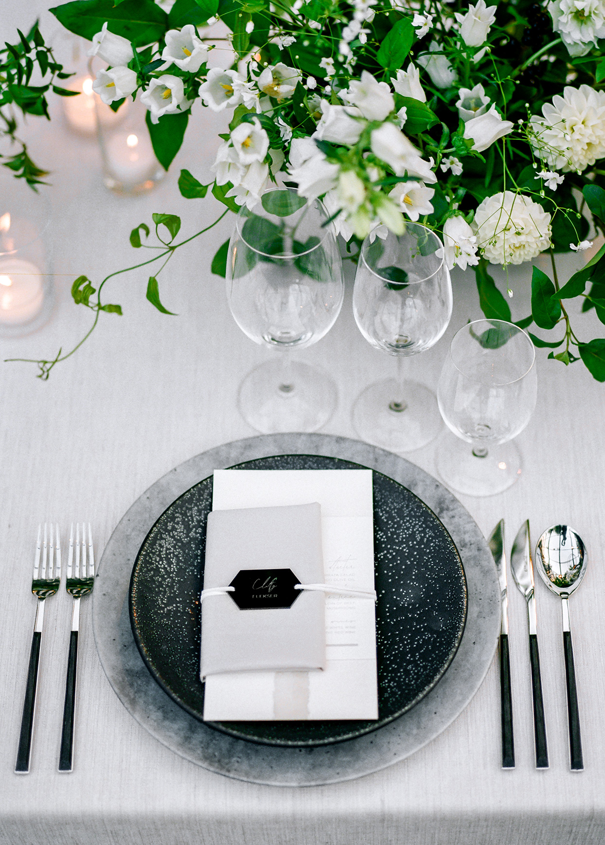 black and white themed reception place settings