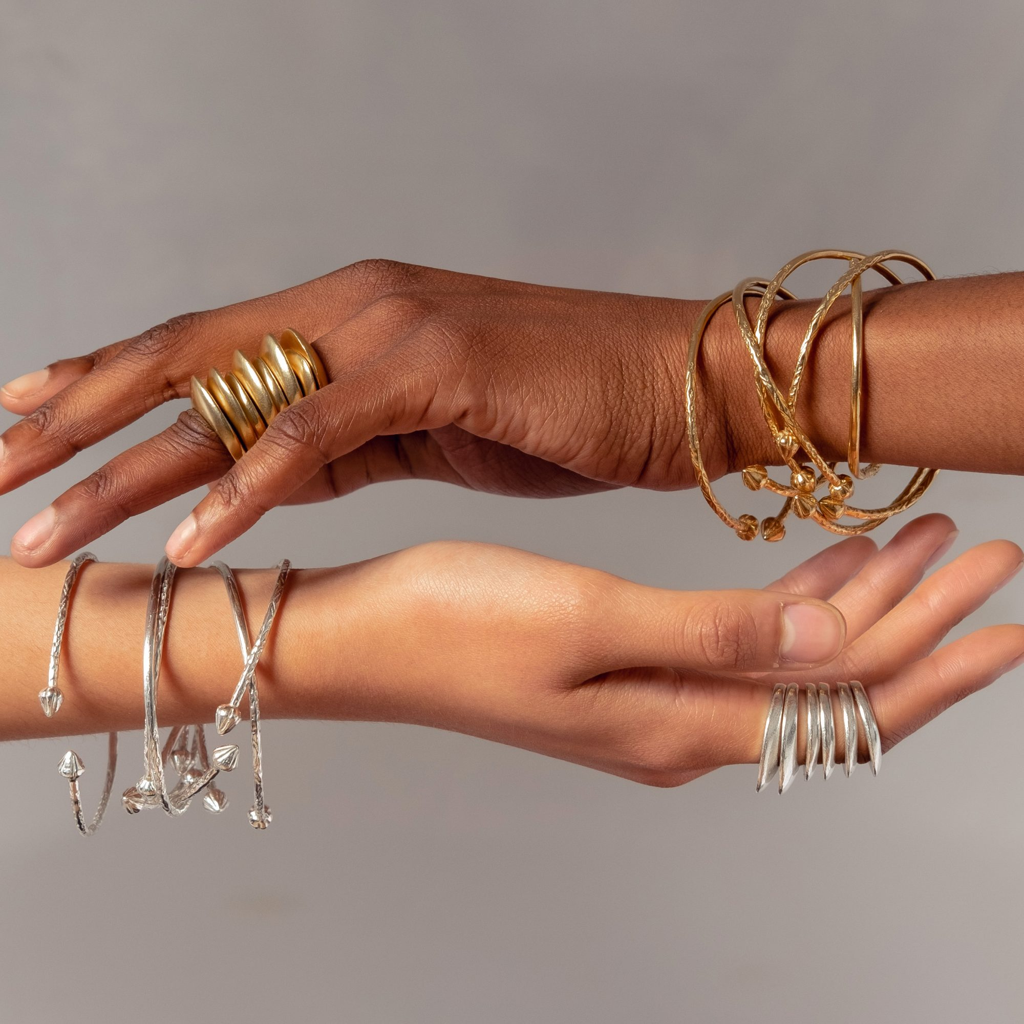 rings and bracelets by Omi Woods