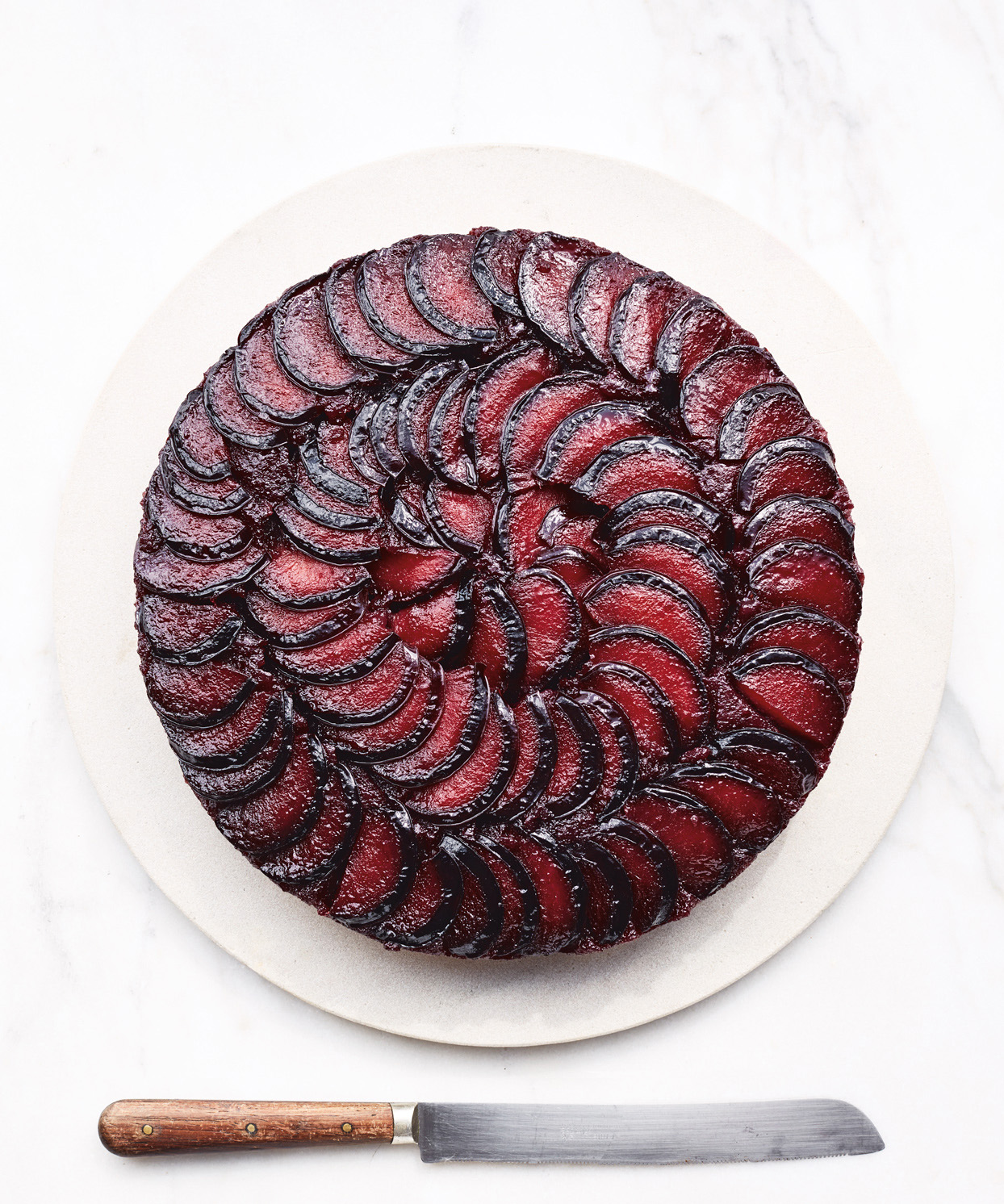 plum cake with knife