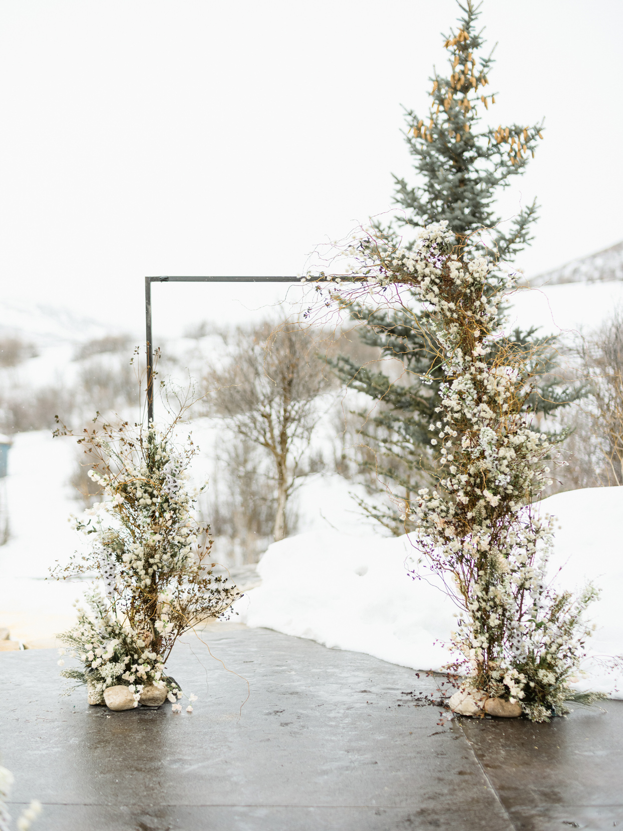 floral wedding arch with white flowers and foliage
