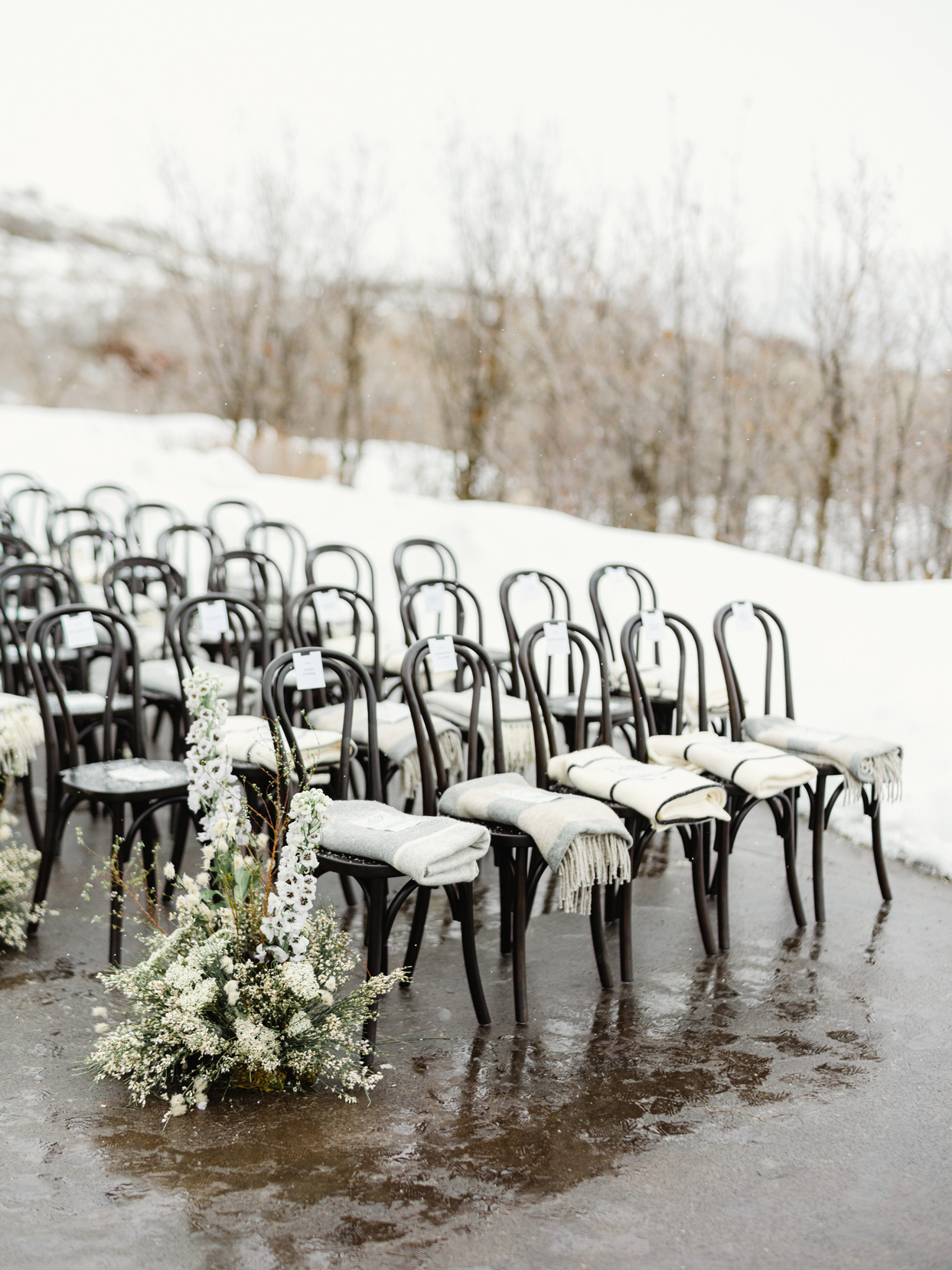 black wedding chairs with individual blankets