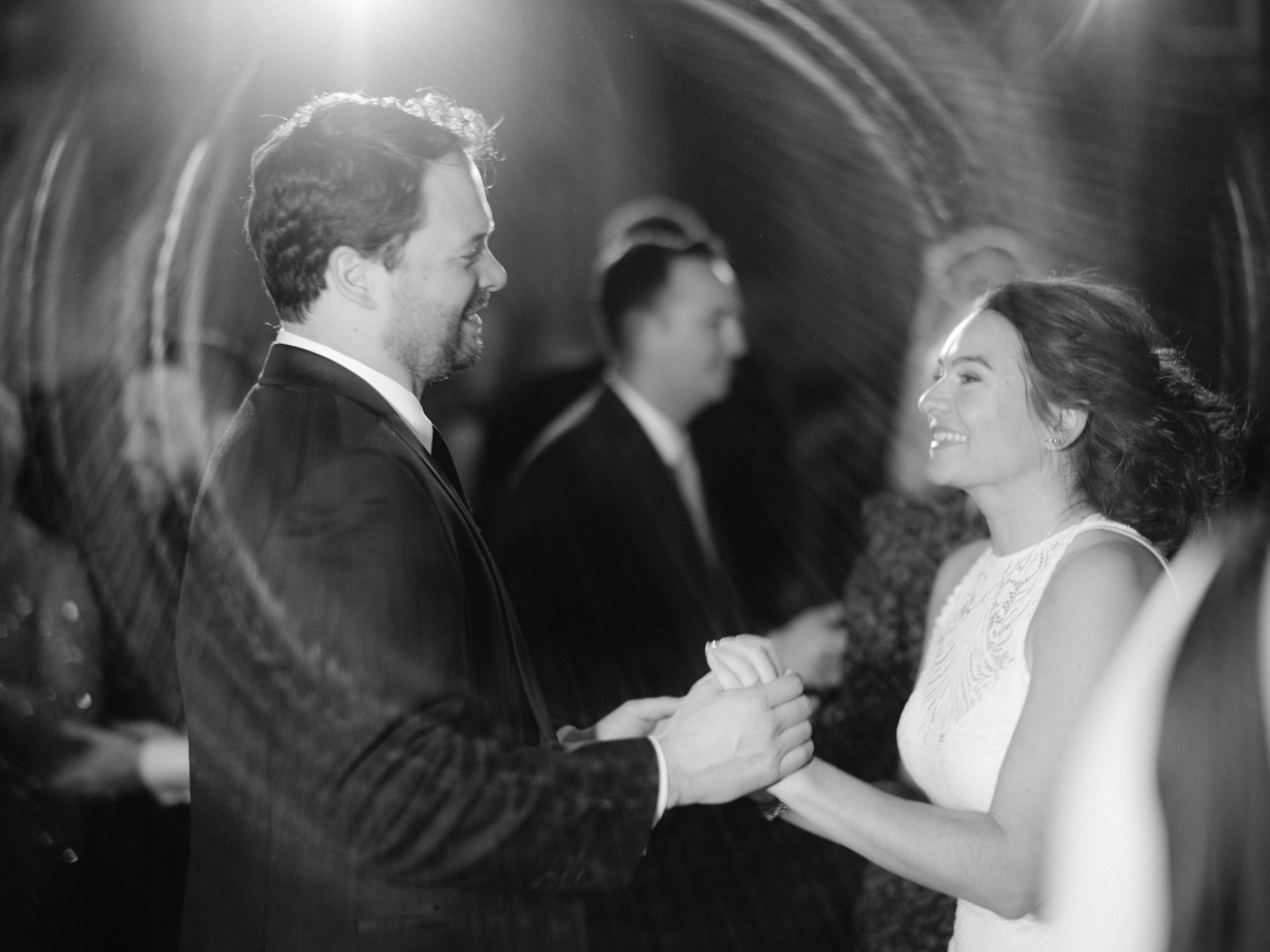 bride and groom smiling at each other during their first dance