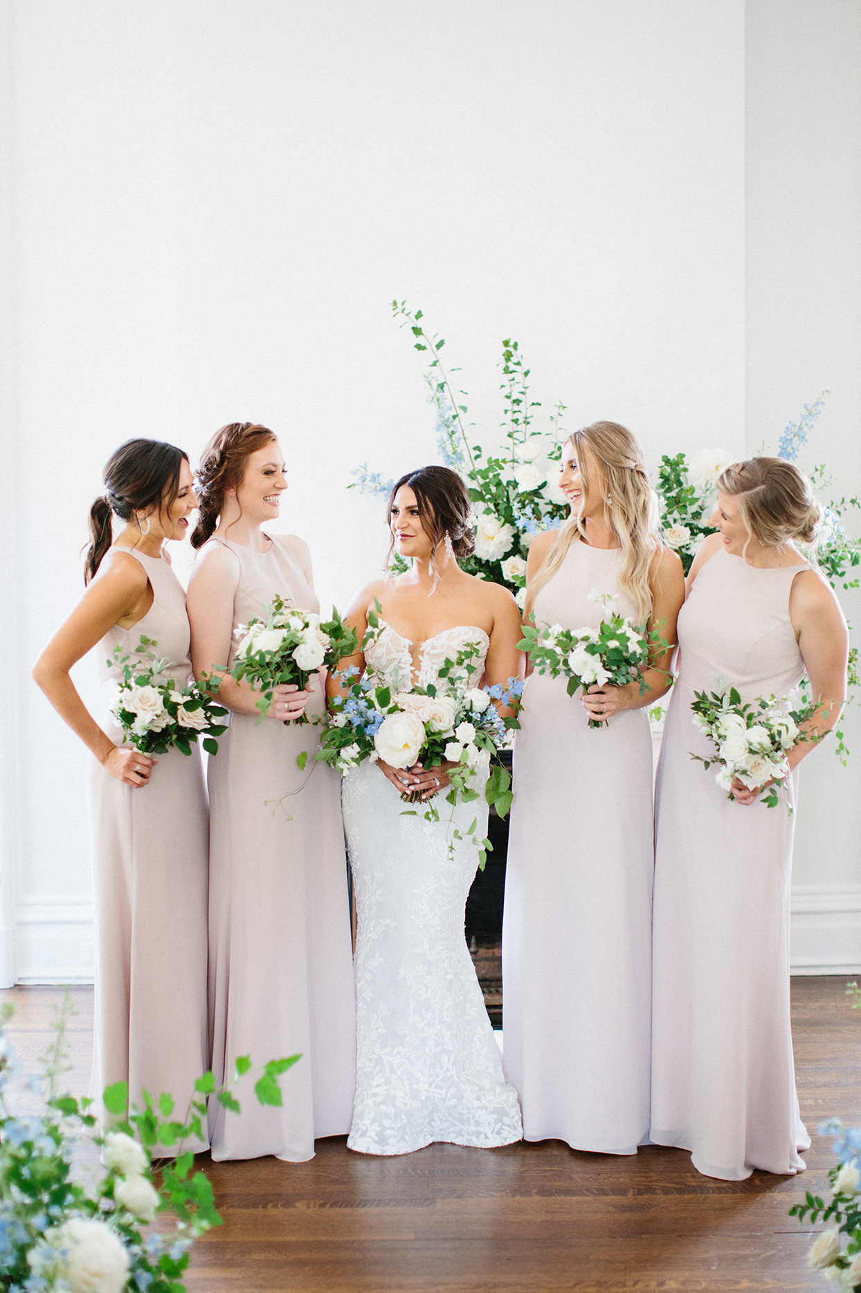 bride with four bridesmaids wearing pale neutral toned dresses
