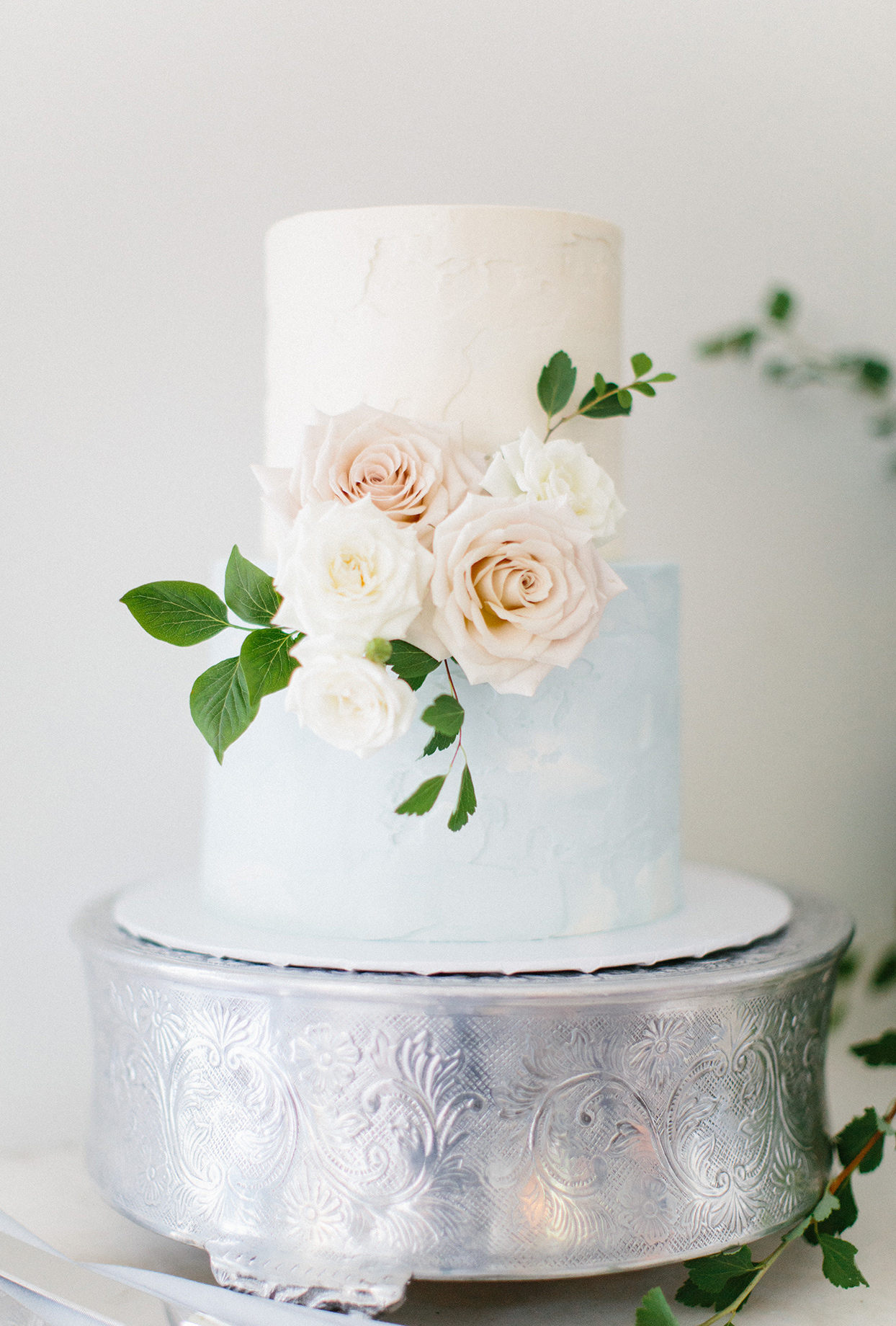 two tiered with and baby blue frosted wedding cake