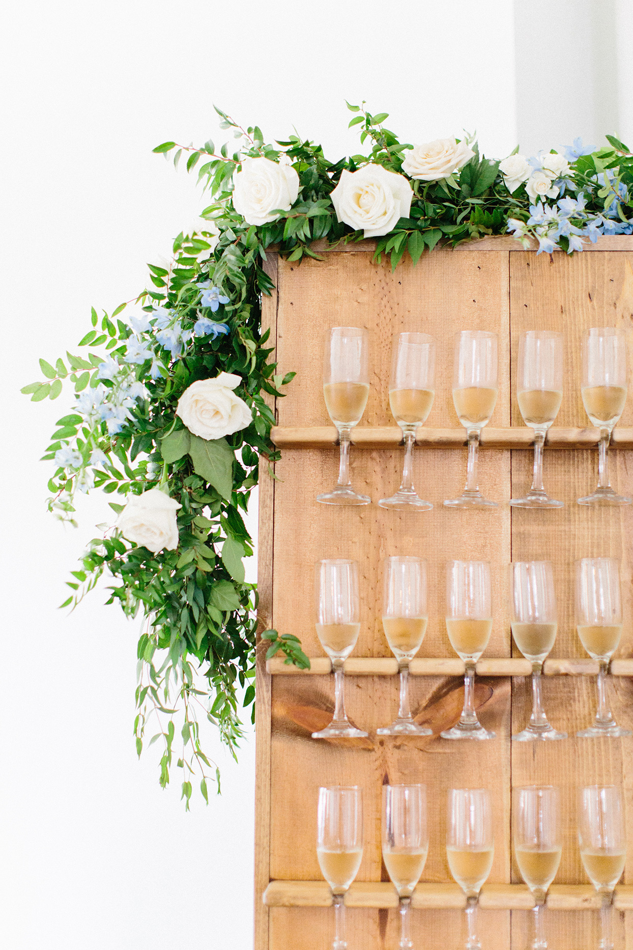 wooden faux wall with champagne display