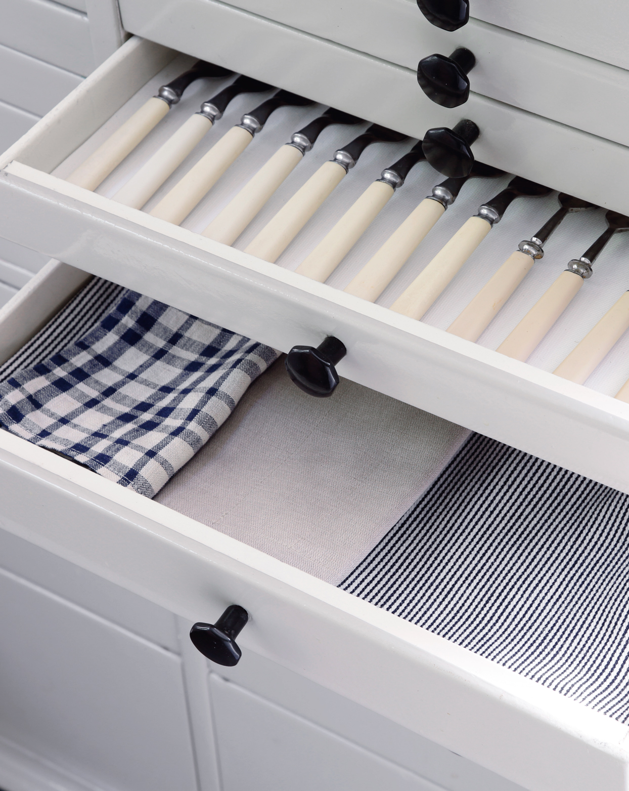 inside of drawer to kitchen storage project