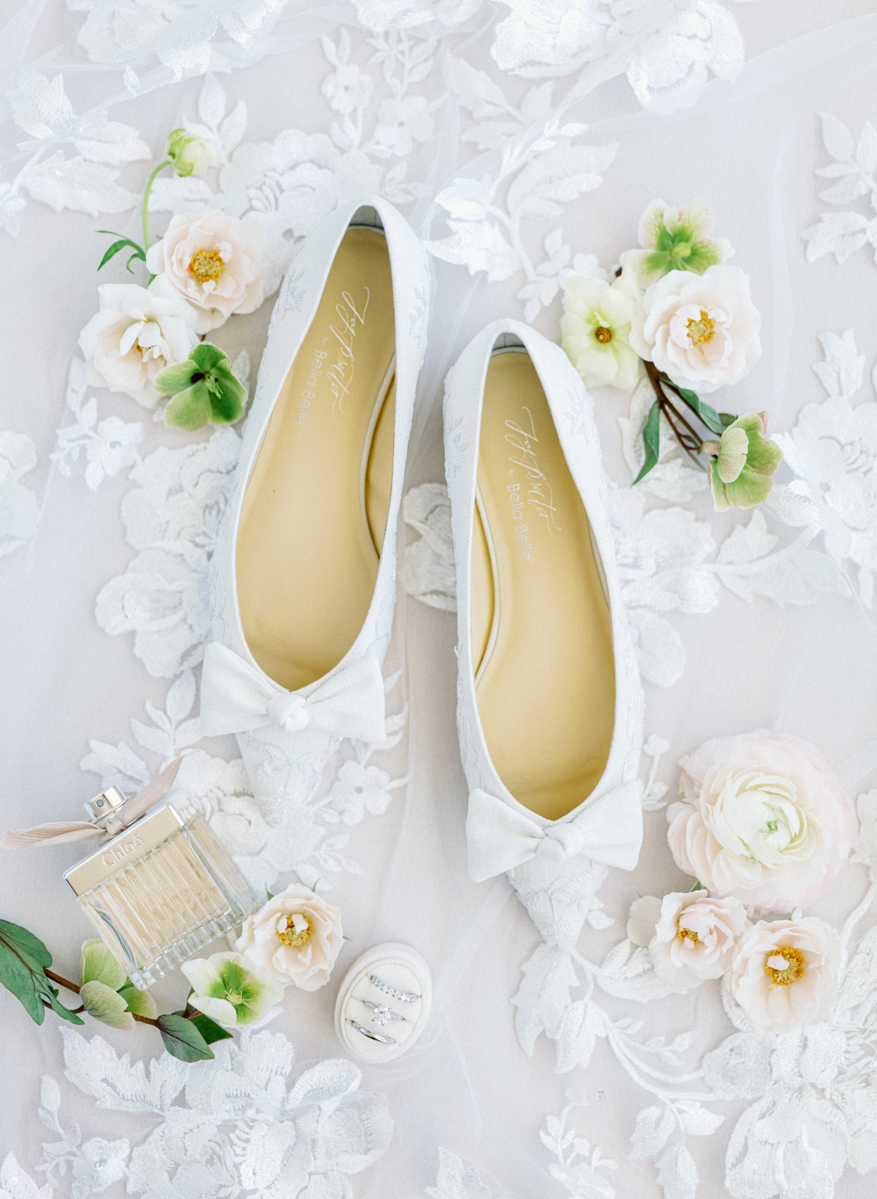 bride's white wedding shoes and accessories