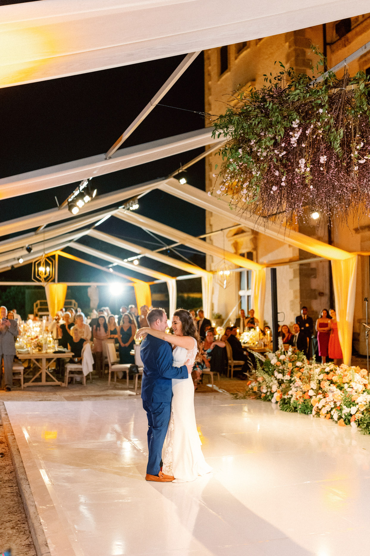 couple first dance under tent