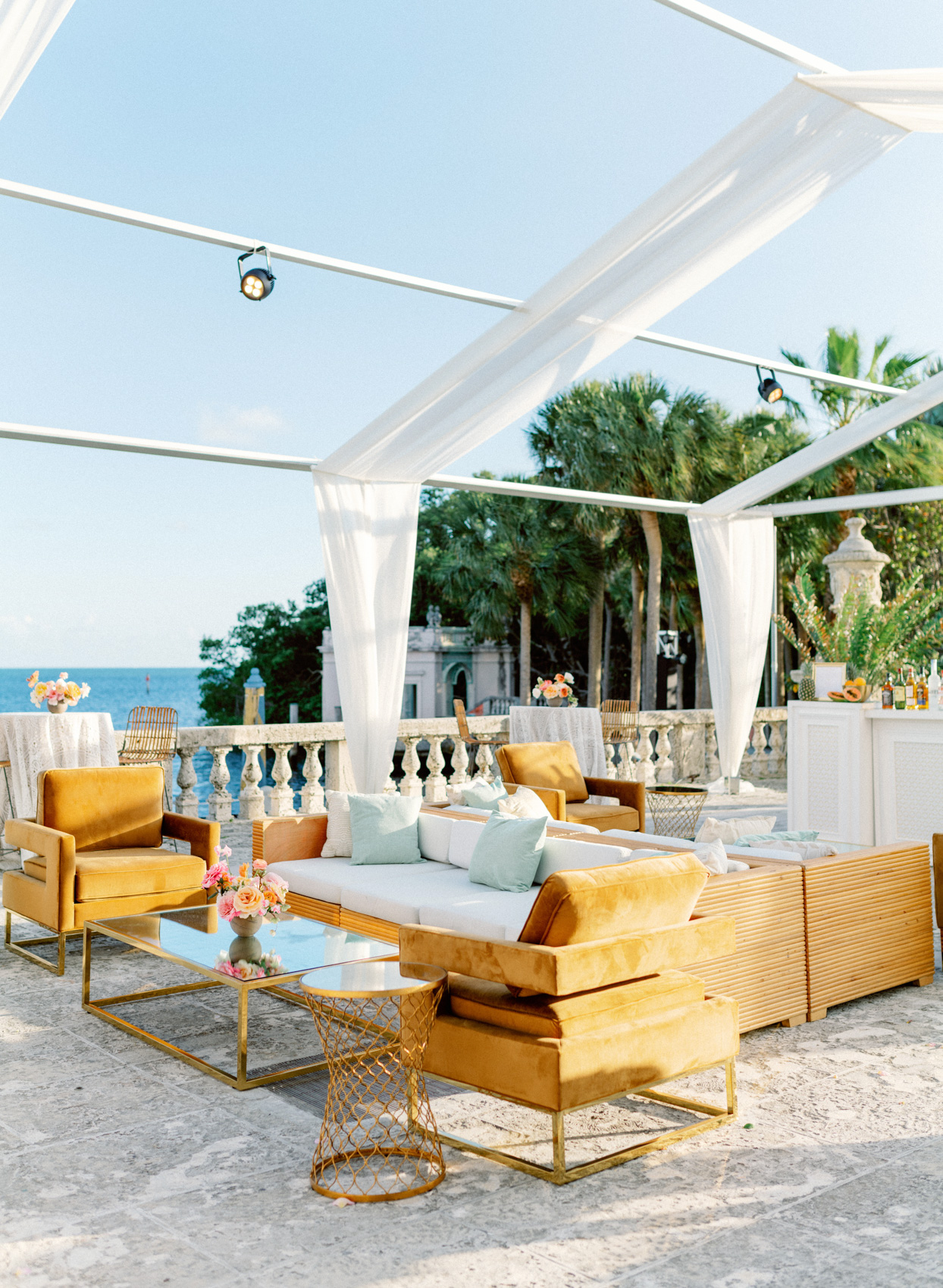 wedding reception lounge golden furniture on balcony with ocean view