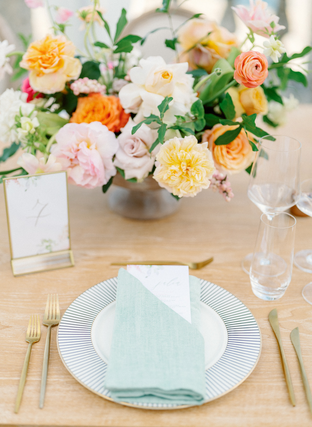 pastel wedding reception place setting with flowers
