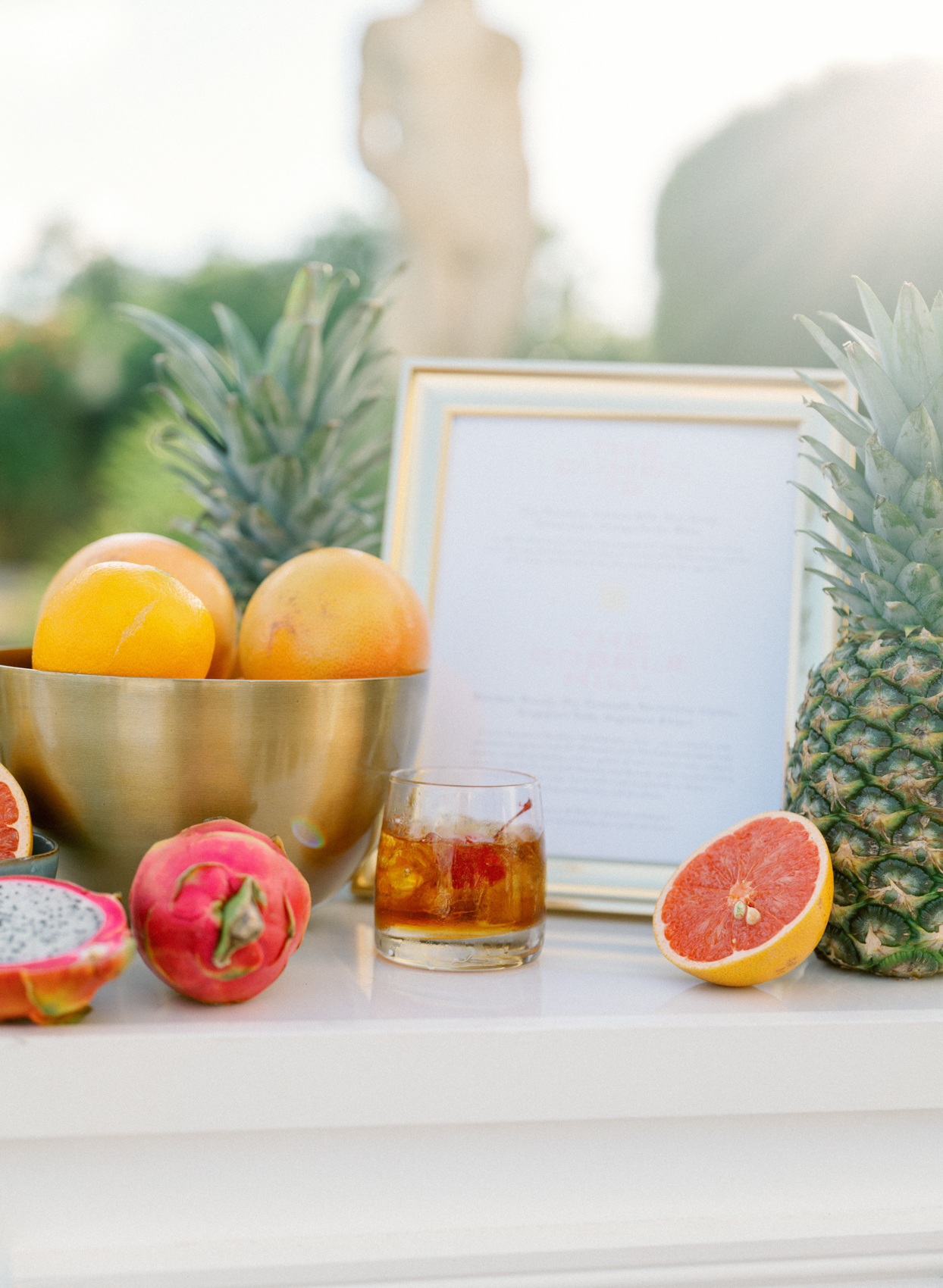 wedding signature cocktail on table with fruit
