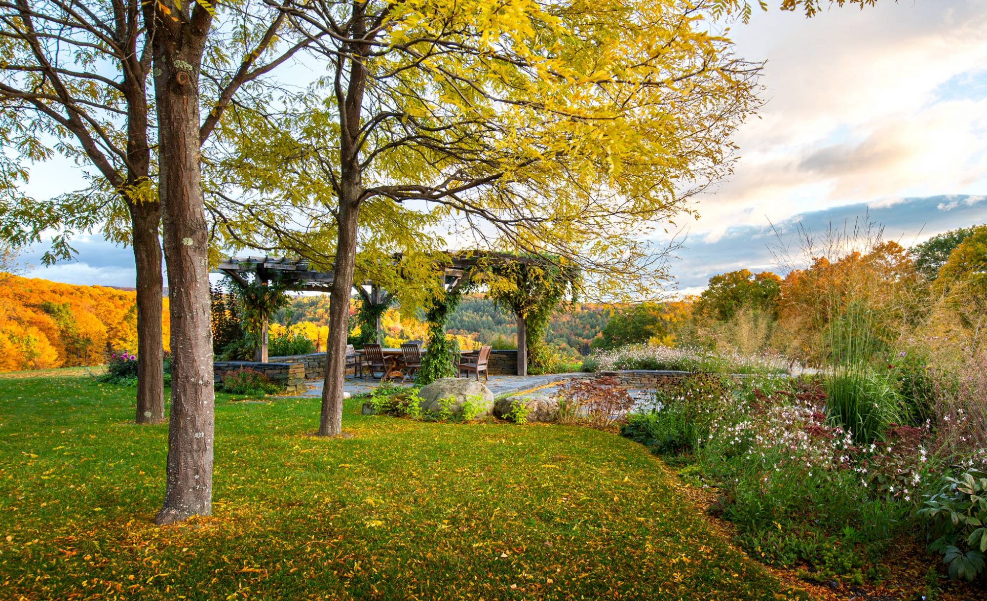 pergola on Vermont property overlooking the fall foliage of the Putney Mountain