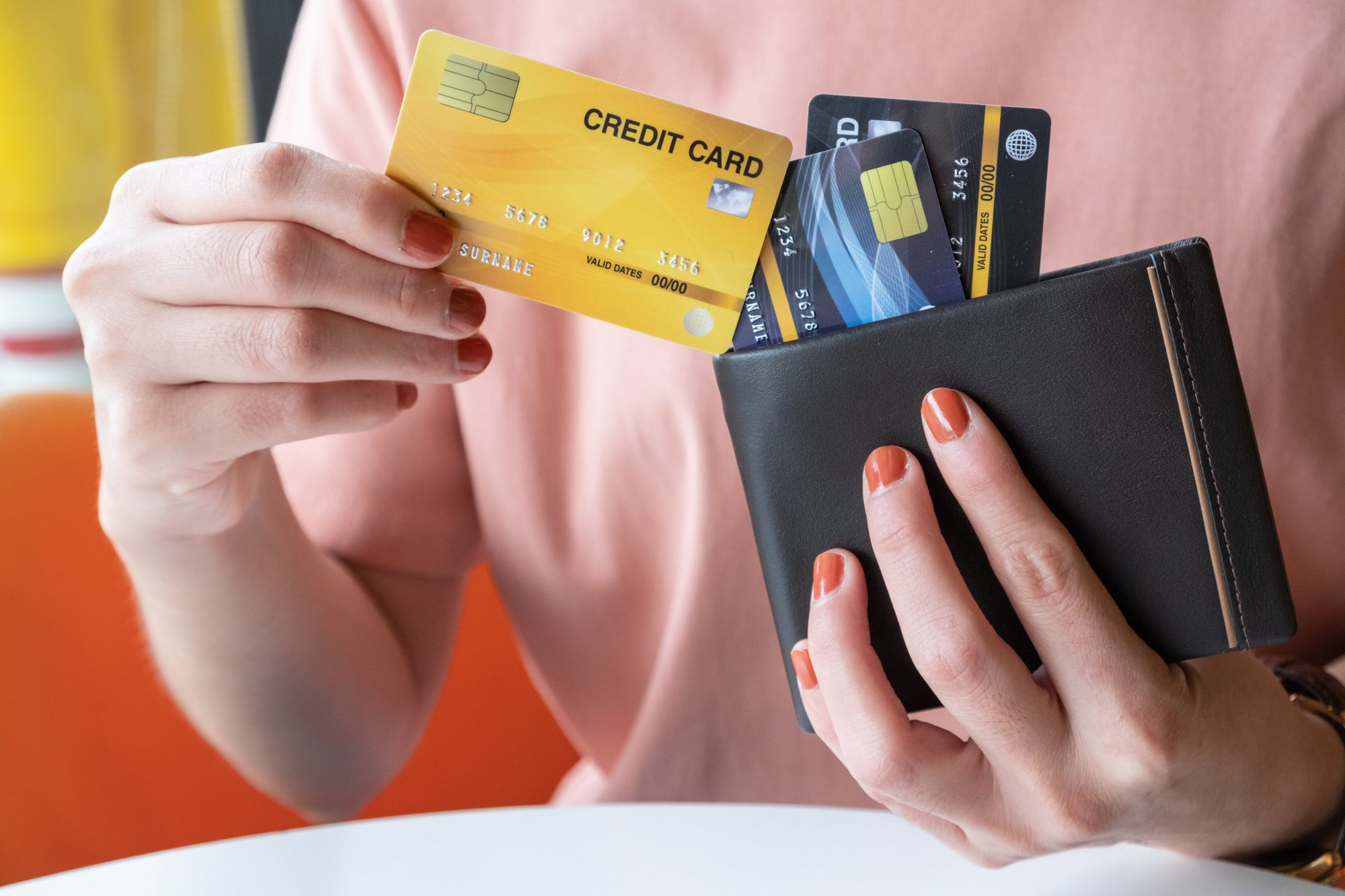 woman with multiple credit cards in wallet