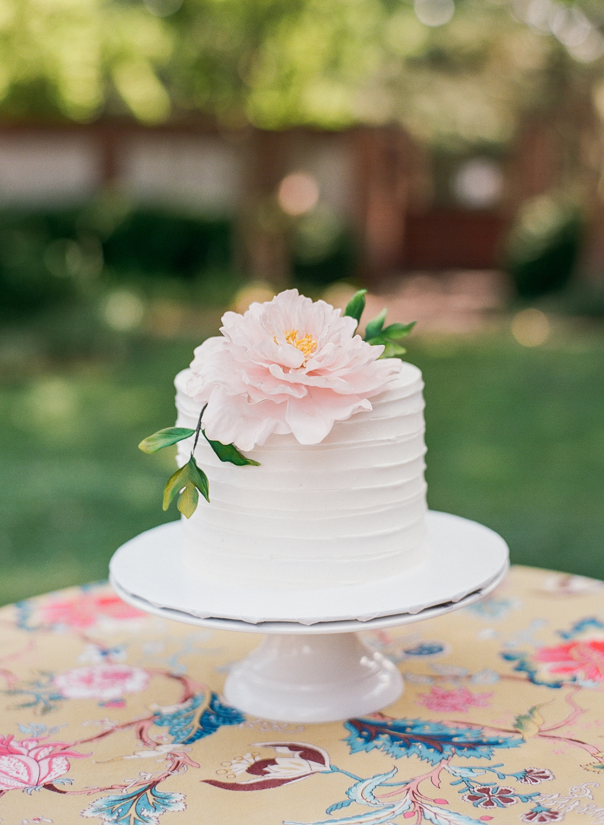 wedding micro cake topped with a sugar peony